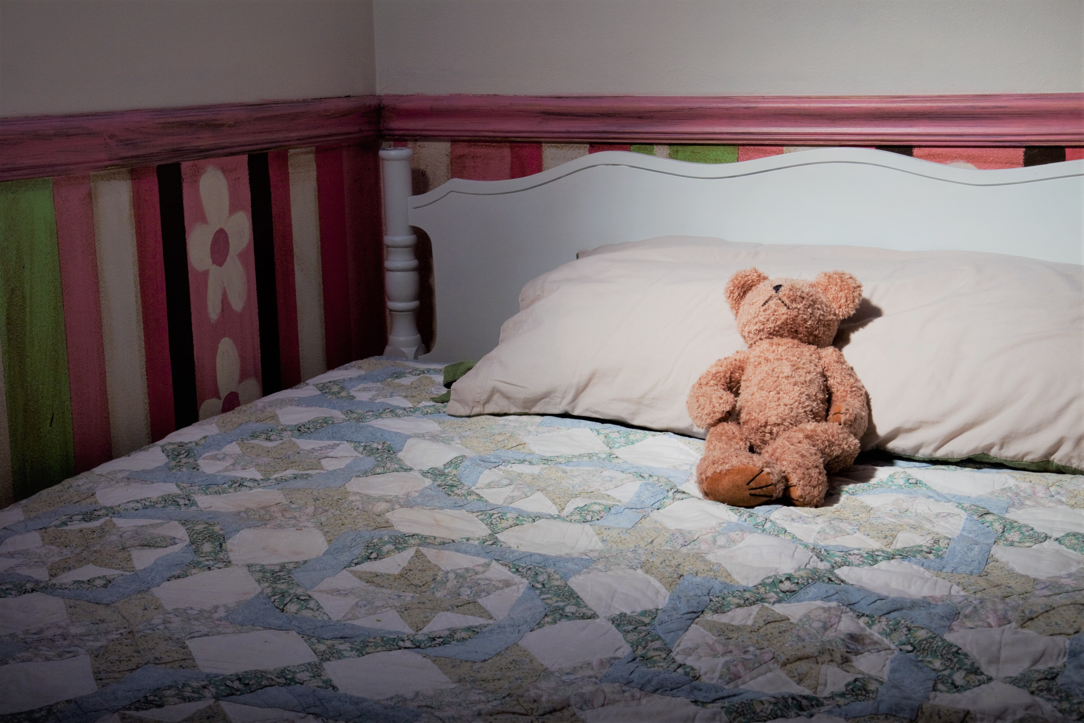 Teddy Bear on Bed Made in Child's Room