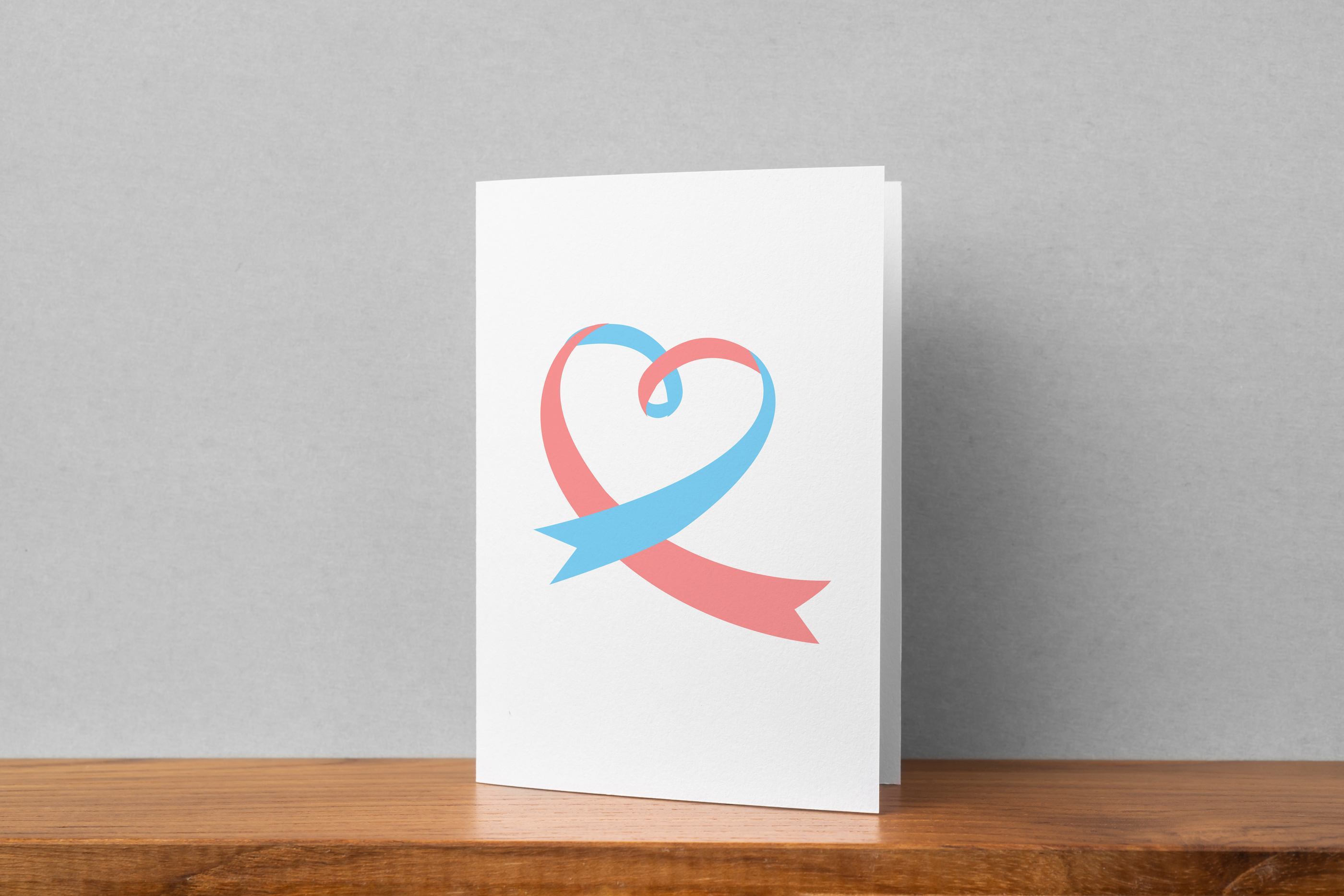 prematurity pregancy loss ribbon on greeting card on shelf