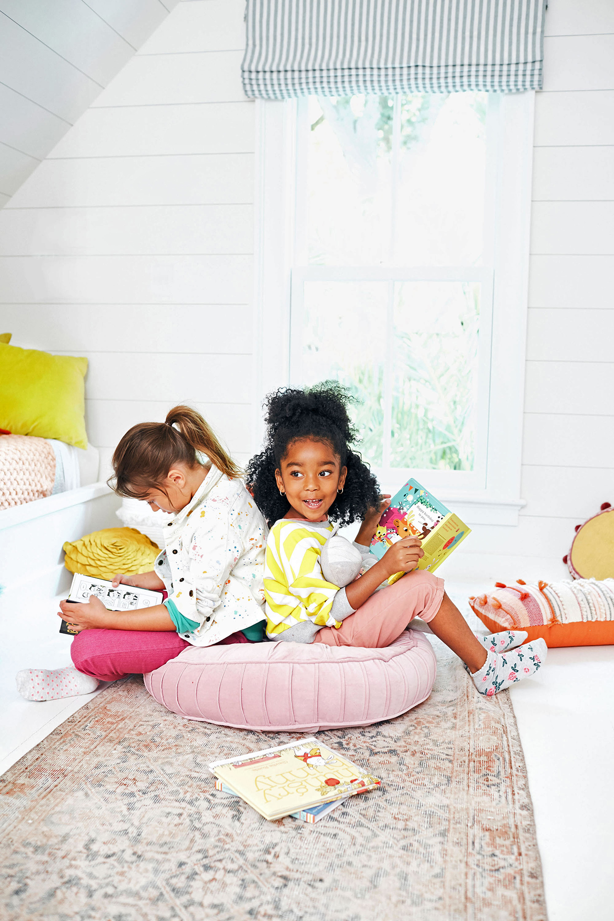 girls reading on cushion