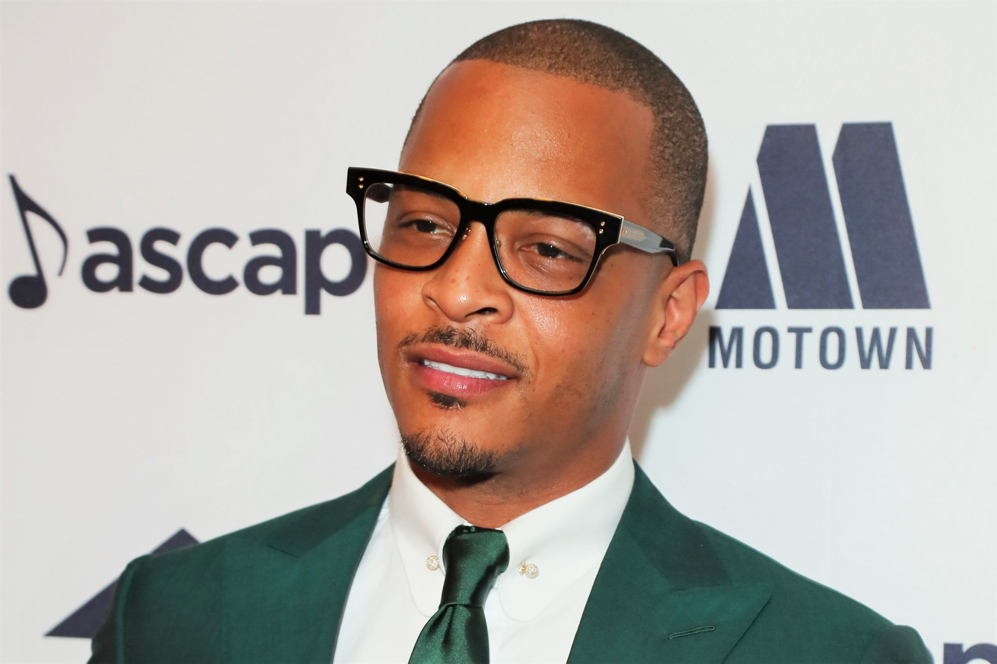 Rapper T.I. wearing glasses in Green suit at 2019 ASCAP Rhythm and Soul Music Awards