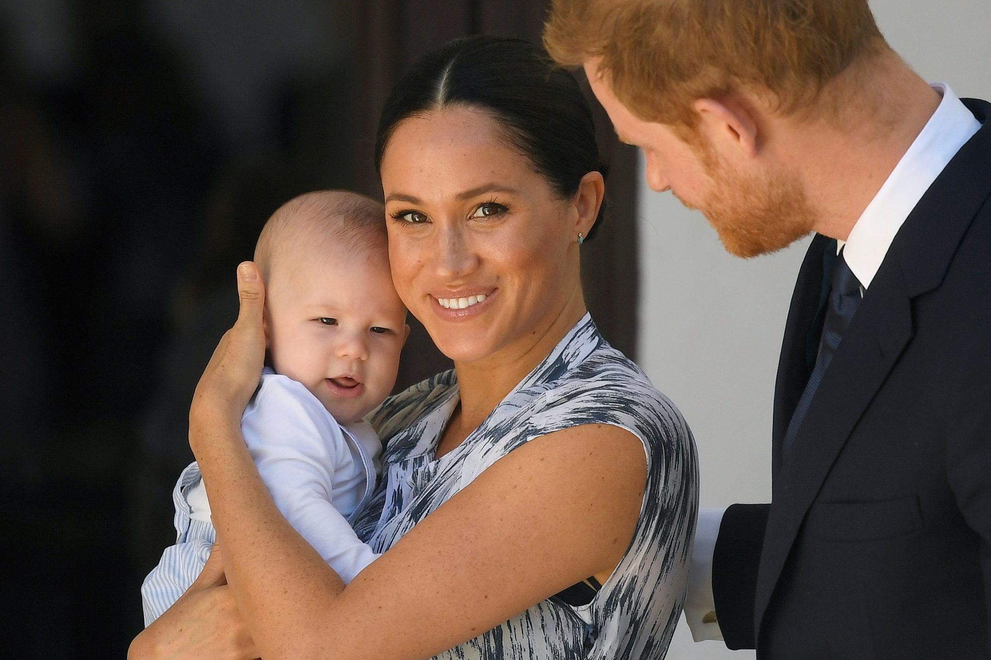 Smiling Meghan Markle Holding Baby Archie with Prince Harry