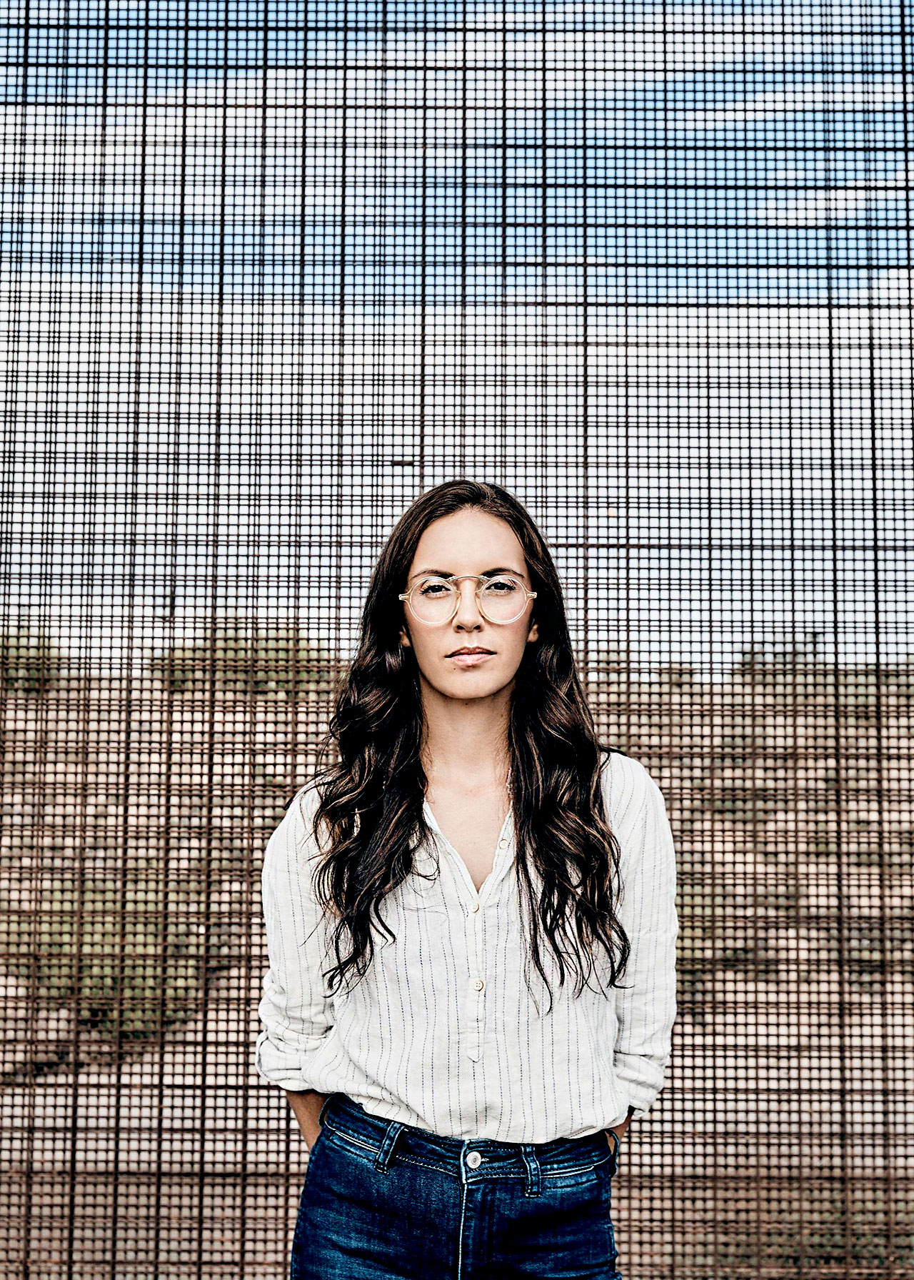 Paola Mendoza at the border fence in El Paso