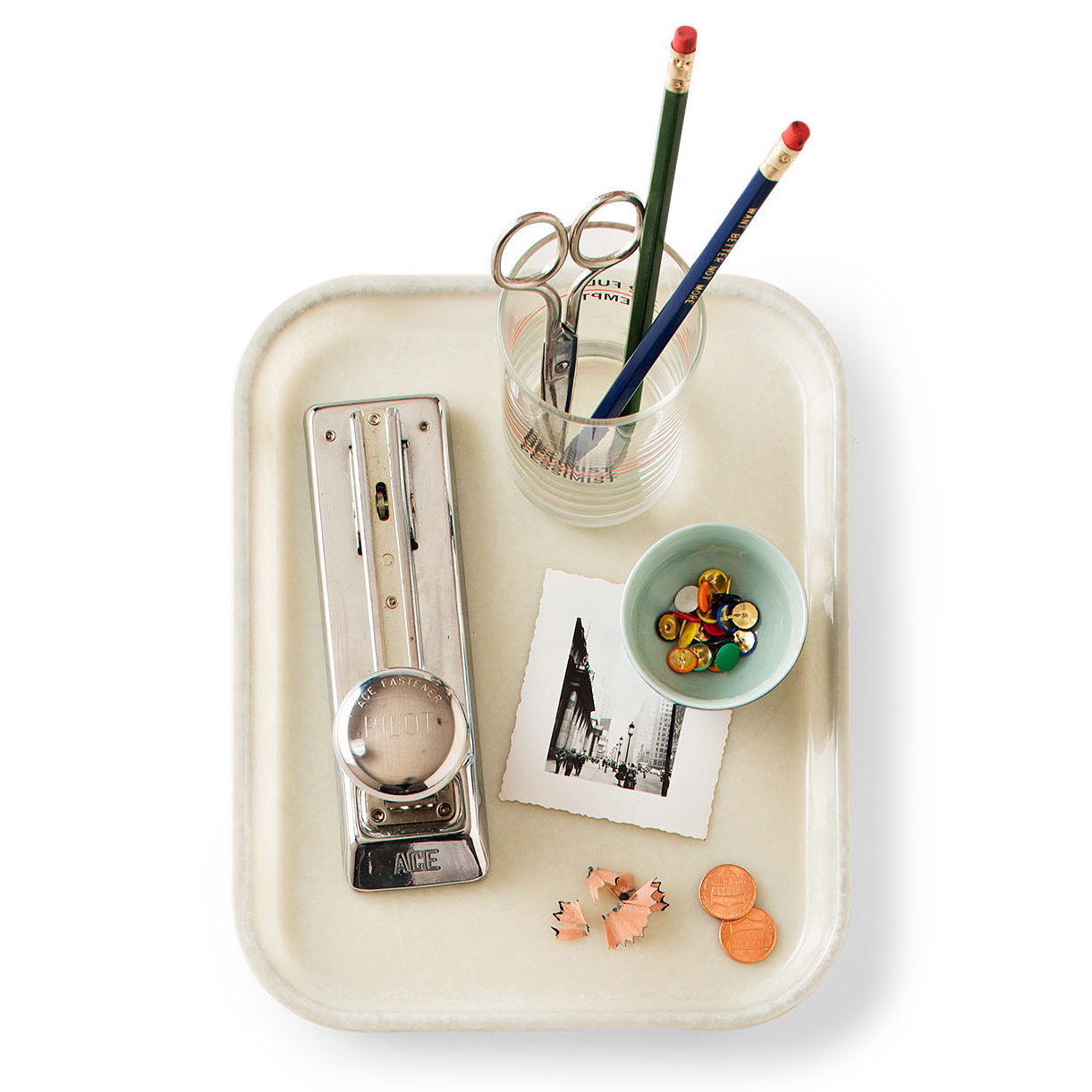 glass with pencils scissors bowl of tacks photo on tray
