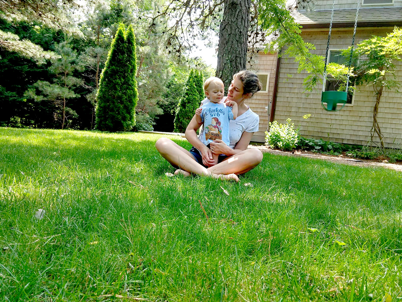 Woman in yard with child