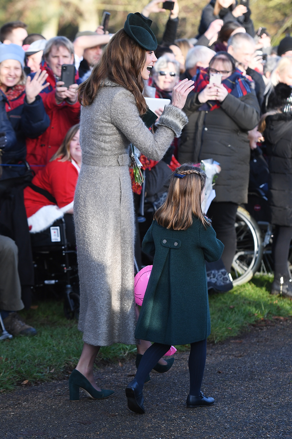 The Duchess of Cambridge and Princess Charlotte meet well wishers after attending the Christmas Day morning church service at St Mary Magdalene Church in Sandringham, Norfolk. (Photo by Joe Giddens/PA Images via Getty Images)