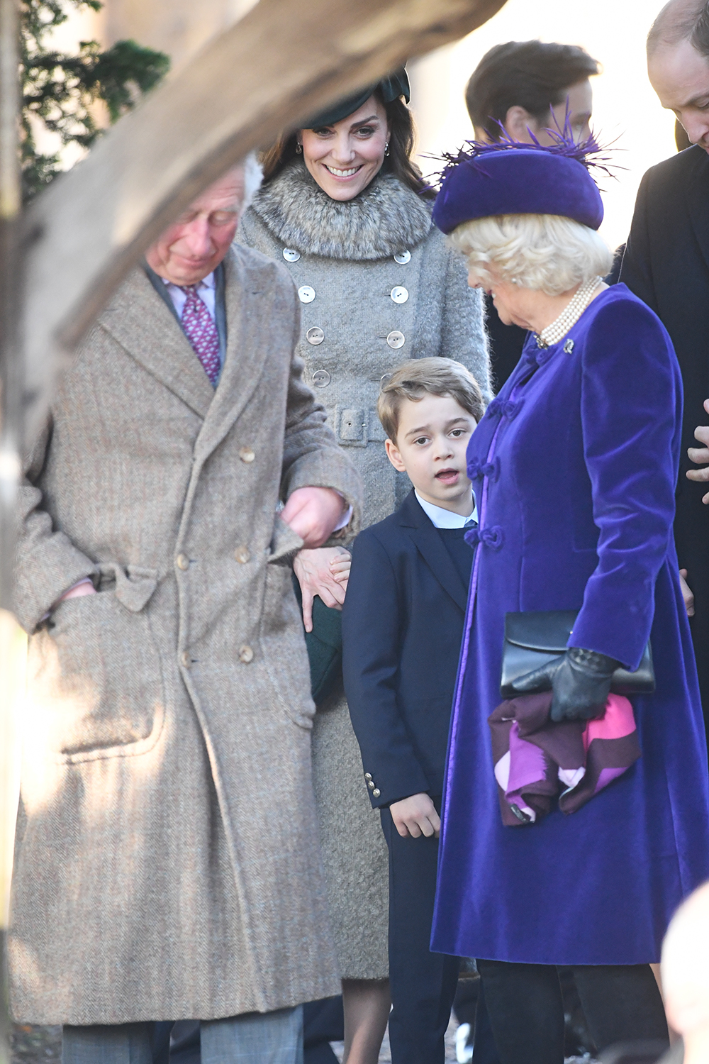 The Prince of Wales, the Duchess of Cambridge, Prince George and the Duchess of Cornwall after attending the Christmas Day morning church service at St Mary Magdalene Church in Sandringham, Norfolk. (Photo by Joe Giddens/PA Images via Getty Images)