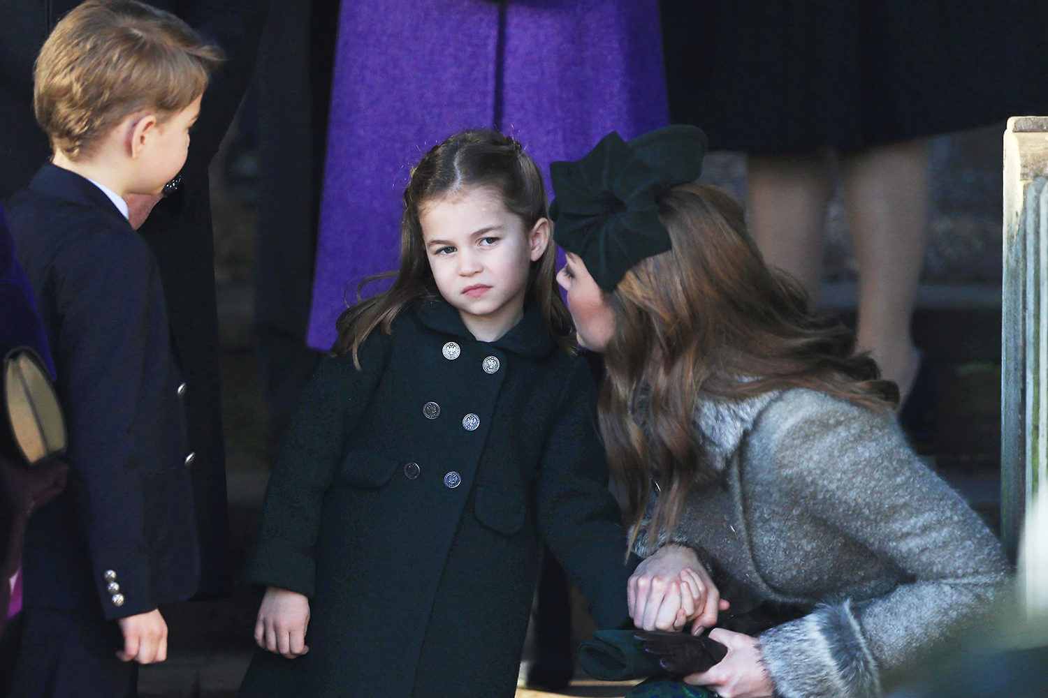 KING'S LYNN, ENGLAND - DECEMBER 25: Catherine, Duchess of Cambridge speaks to Princess Charlotte as Prince George watches as they leave after attending the Christmas Day Church service at Church of St Mary Magdalene on the Sandringham estate on December 25, 2019 in King's Lynn, United Kingdom. (Photo by Stephen Pond/Getty Images)