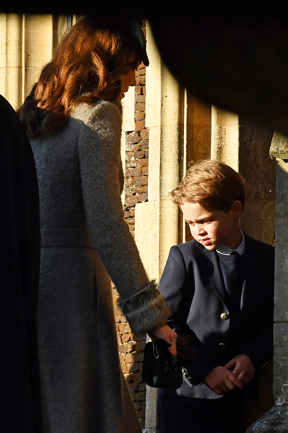 Britain's Prince George of Cambridge (R) and his mother Britain's Catherine, Duchess of Cambridge arrive for the Royal Family's traditional Christmas Day service at St Mary Magdalene Church in Sandri ngham, Norfolk, eastern England, on December 25, 2019. (Photo by Ben STANSALL / AFP) (Photo by BEN STANSALL/AFP via Getty Images)