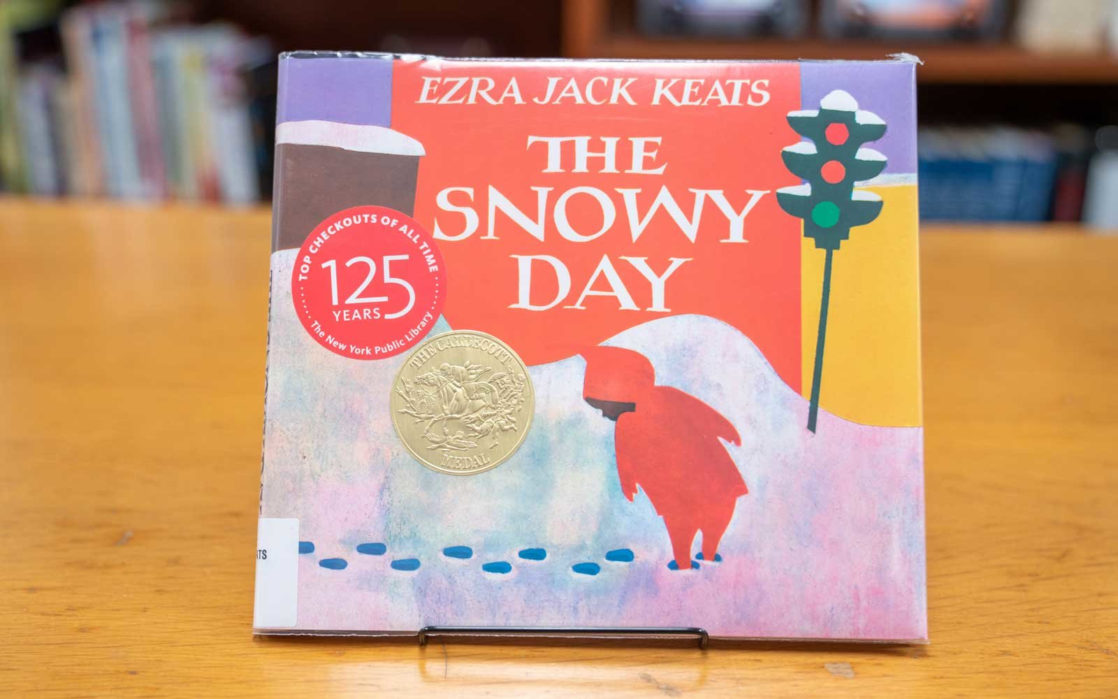 The Snowy Day by Ezra Jack Keats Book on Library Table