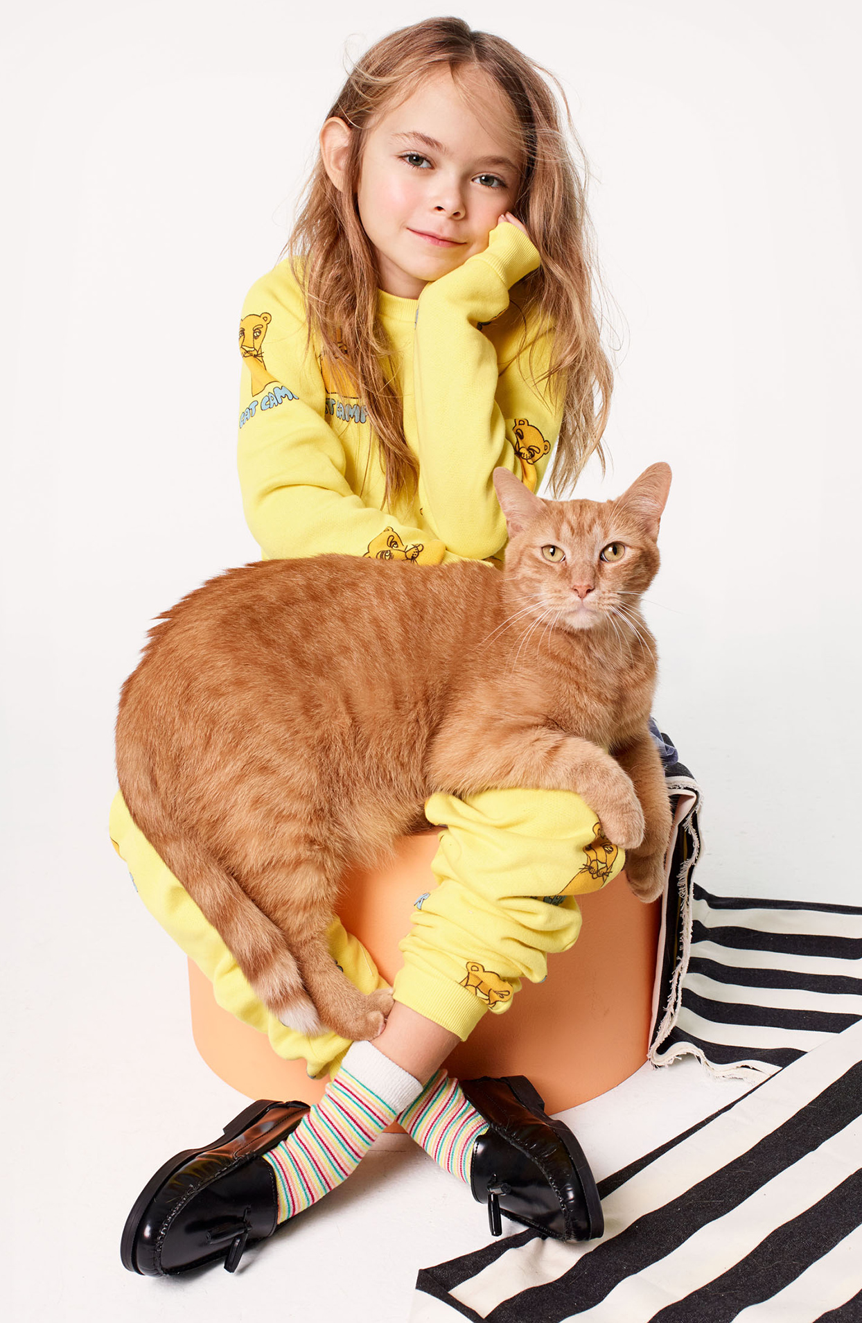 girl sitting with cat on her lap