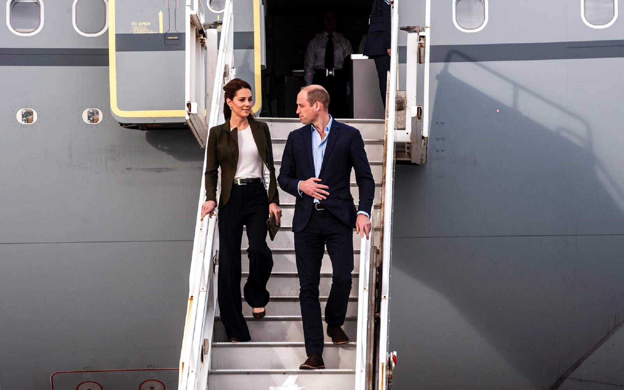 Kate Middleton and Prince William Walking Down Stairs of Plane