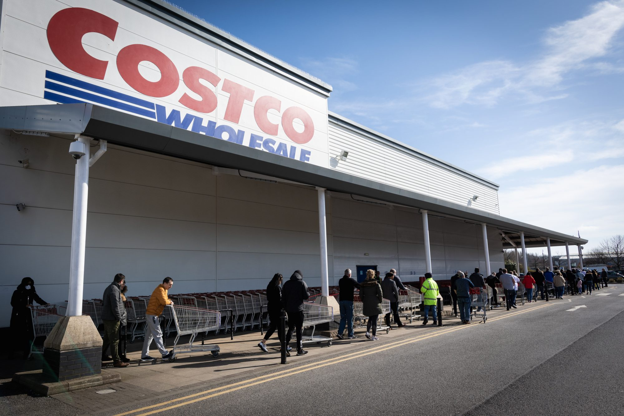 people standing in line in front of costco