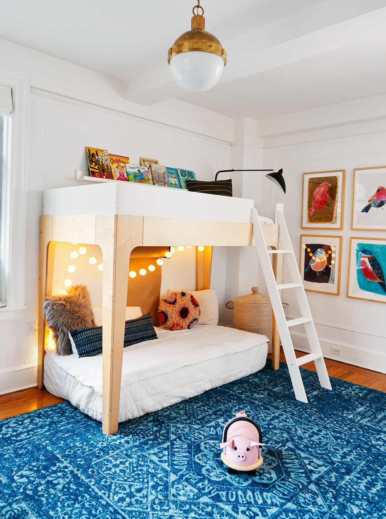 childrens bedroom with bunk beds and blue rug