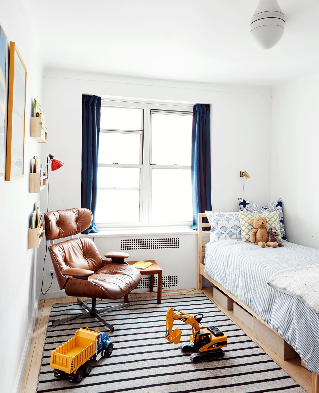 childs bedroom with toy trucks on floor