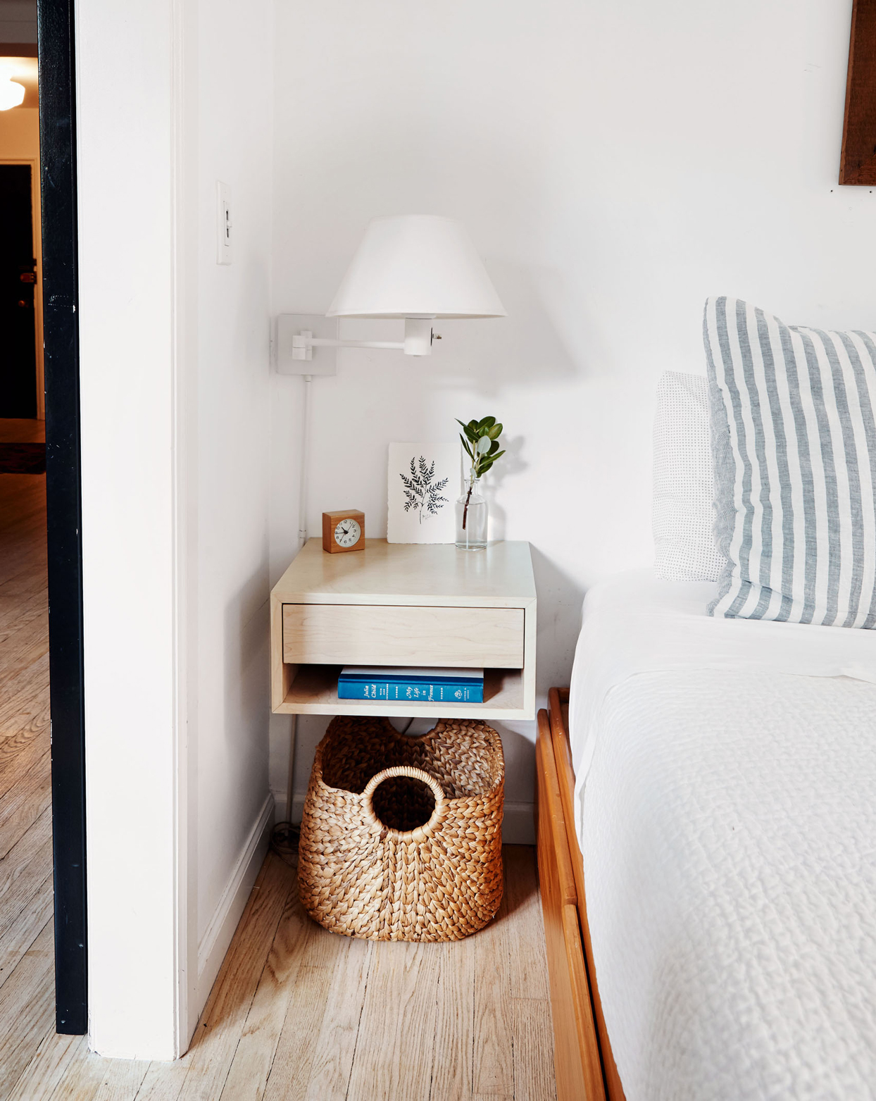 floating nightstand with hamper storage beneath