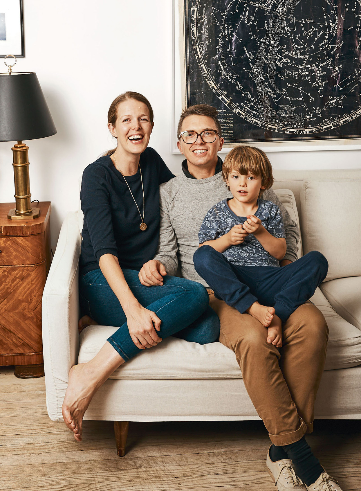 laura fenton sitting on couch with her husband and son