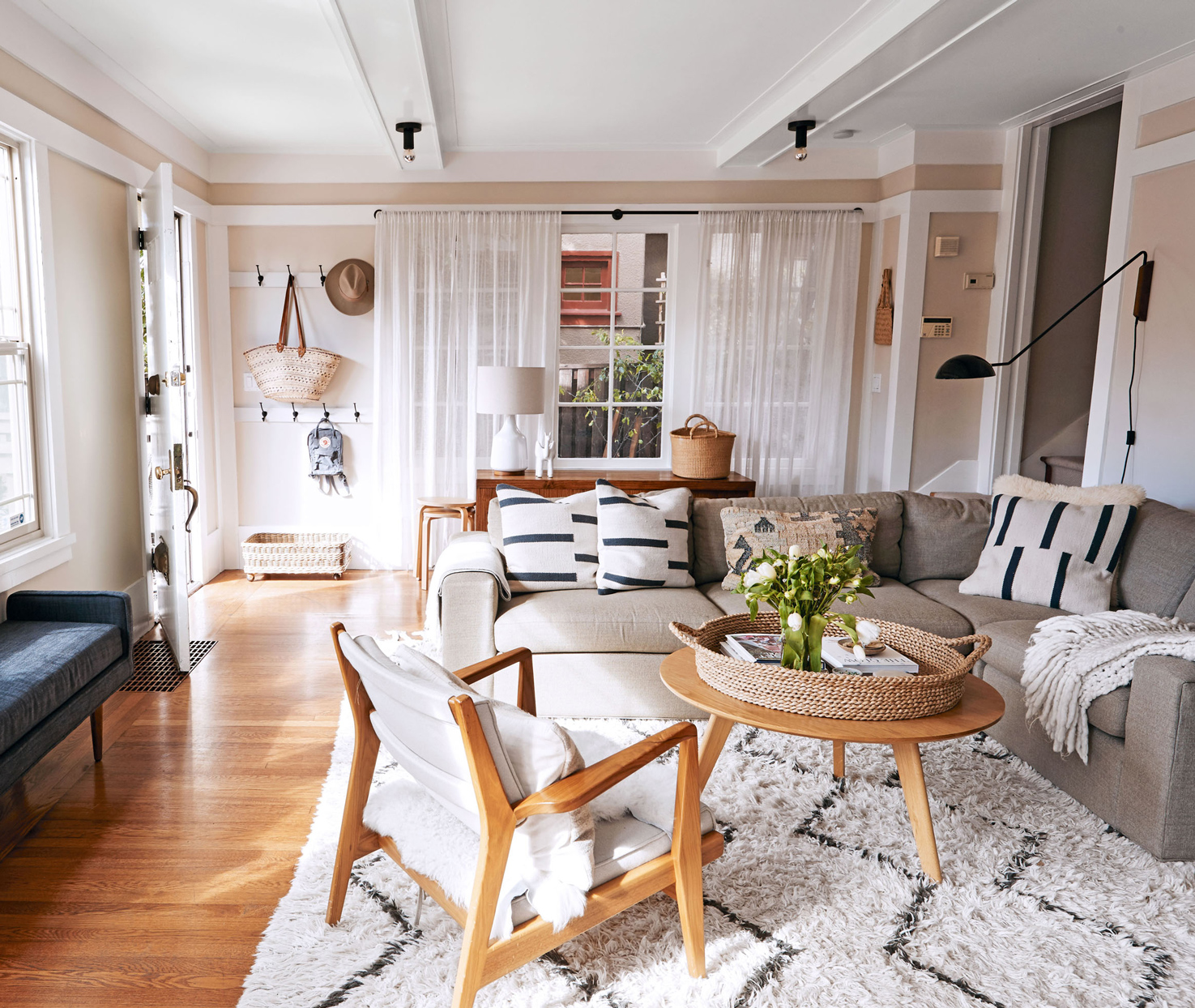 neutral colored living room with l-shaped sofa
