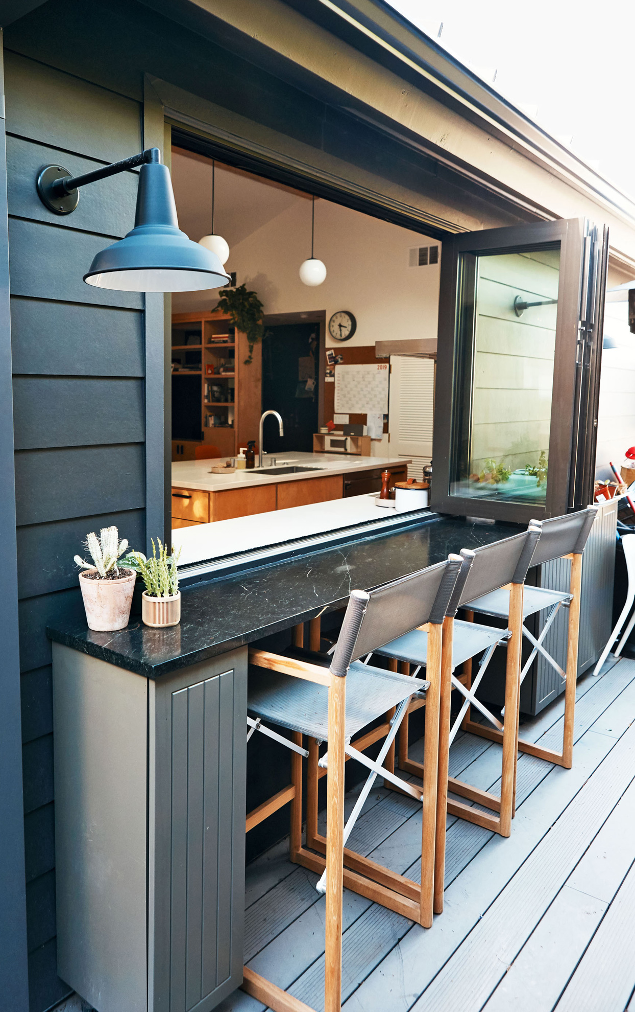 outdoor deck with countertop and seating
