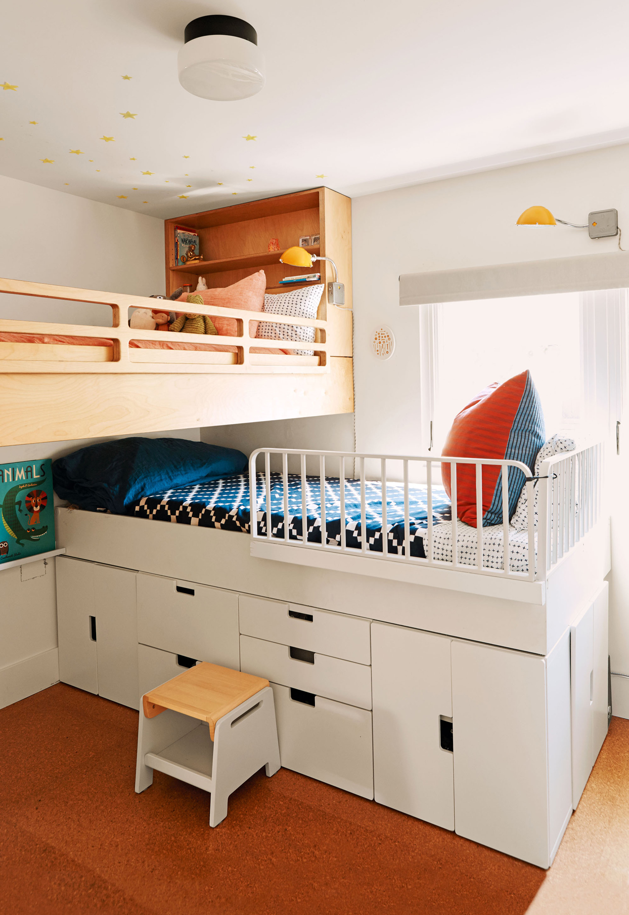 childrens bedroom with stacked beds featuring storage beneath