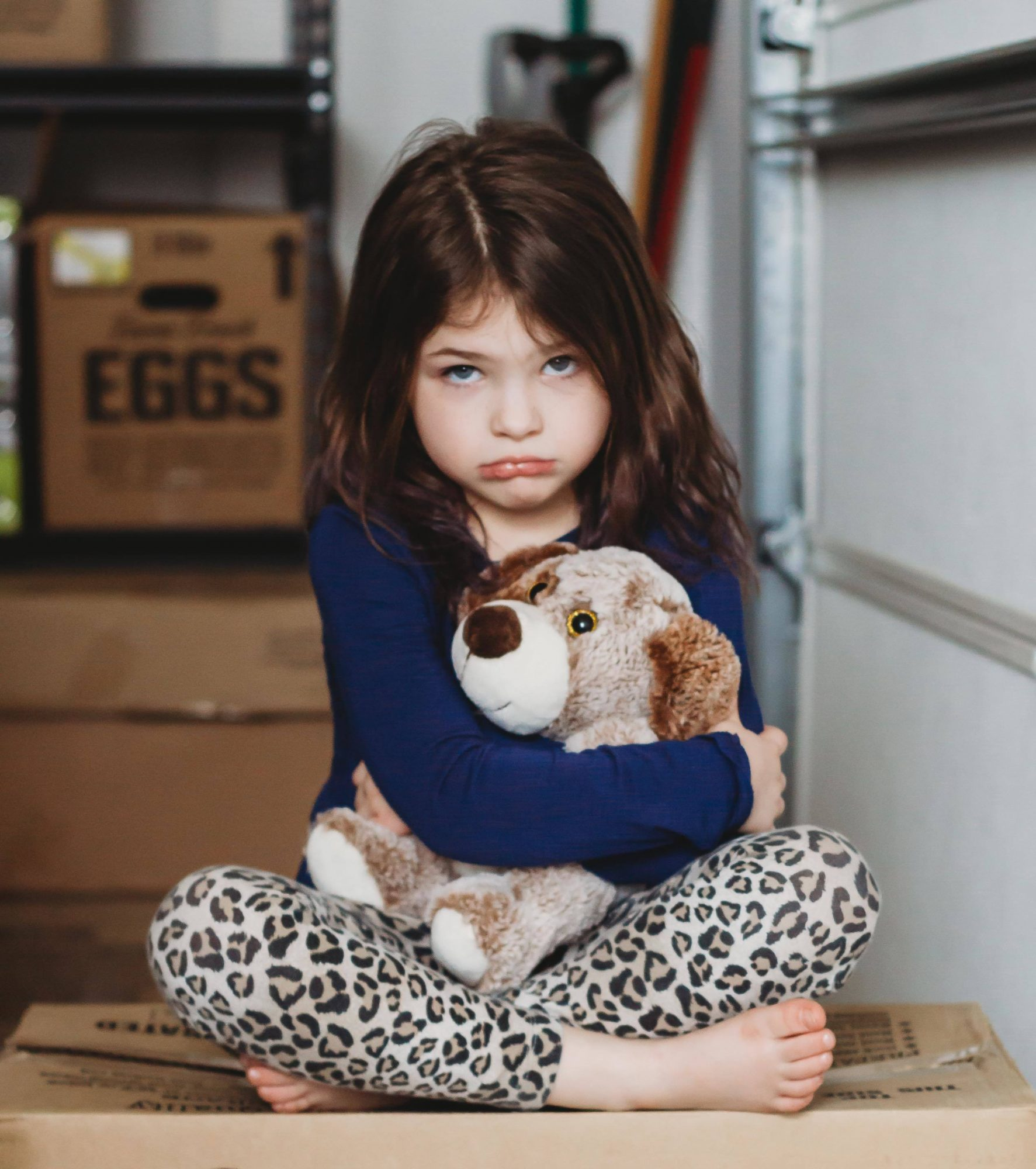 small girl with stuffed animal