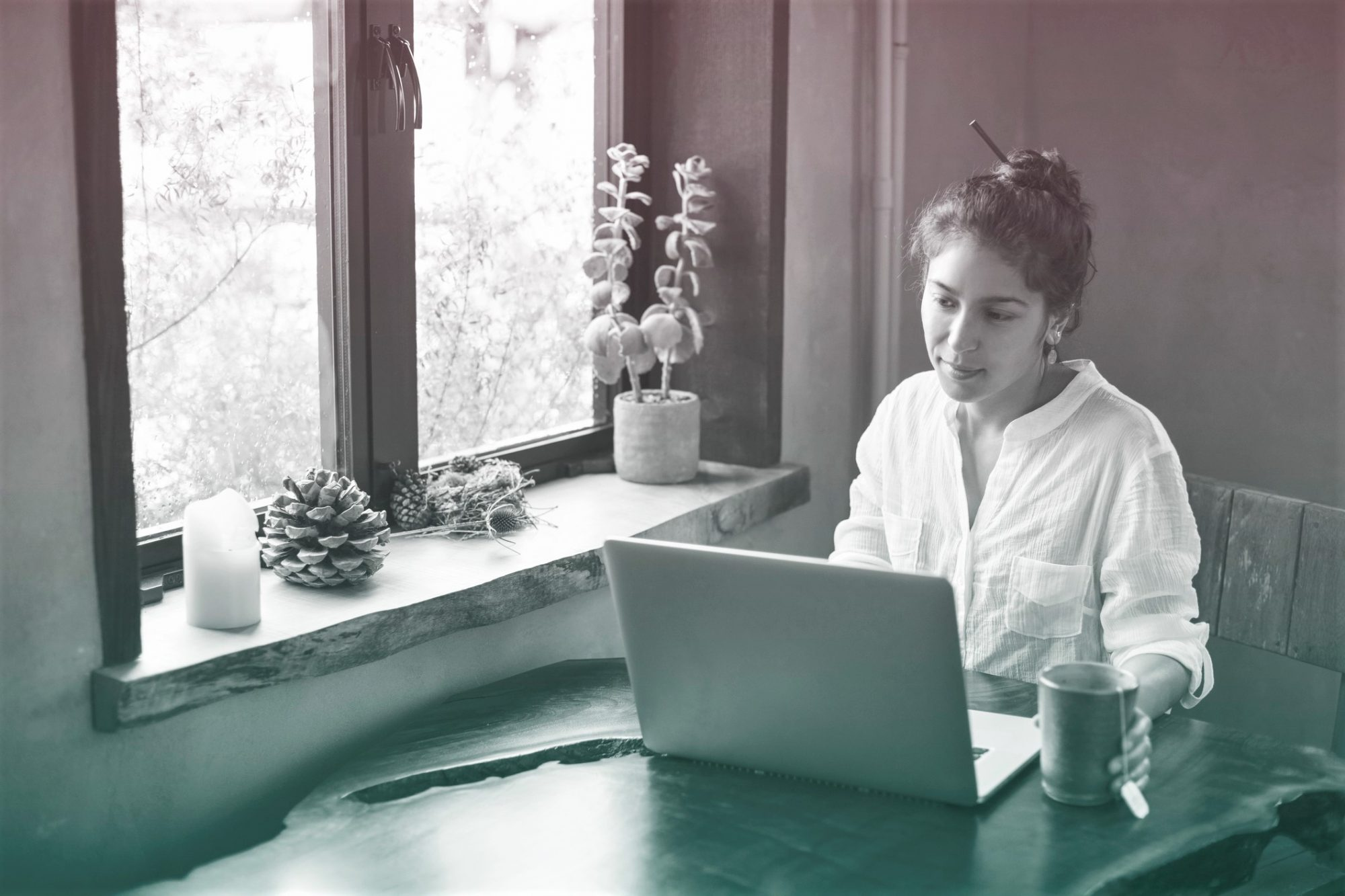 Young Adult Multi-ethnic Woman Working from Home on Laptop