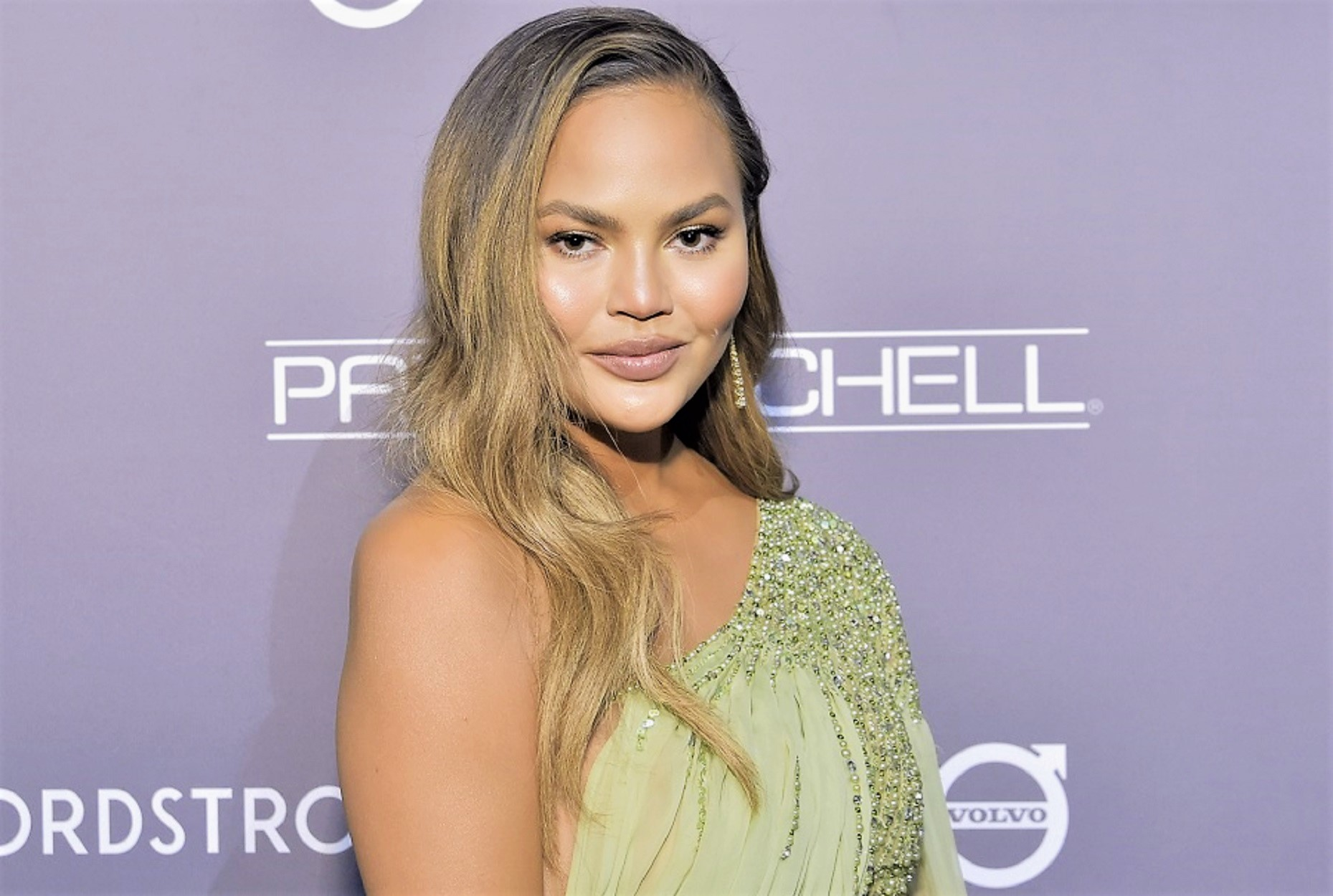 chrissy teigen wearing one shoulder dress