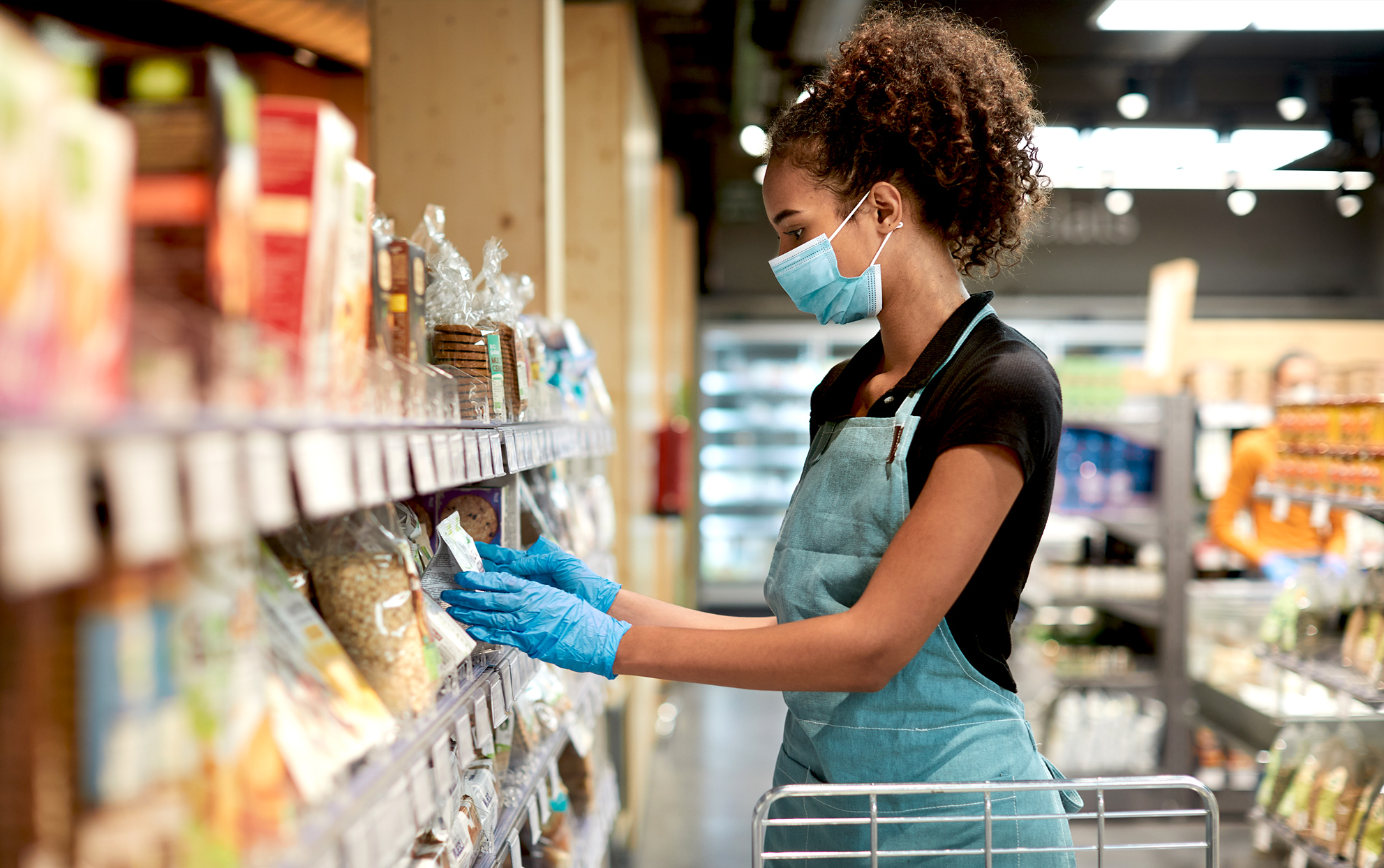 grocer wearing face mask