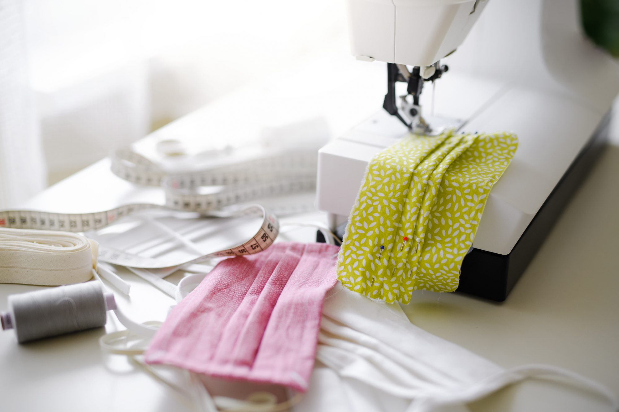 protective face masks on sewing machine
