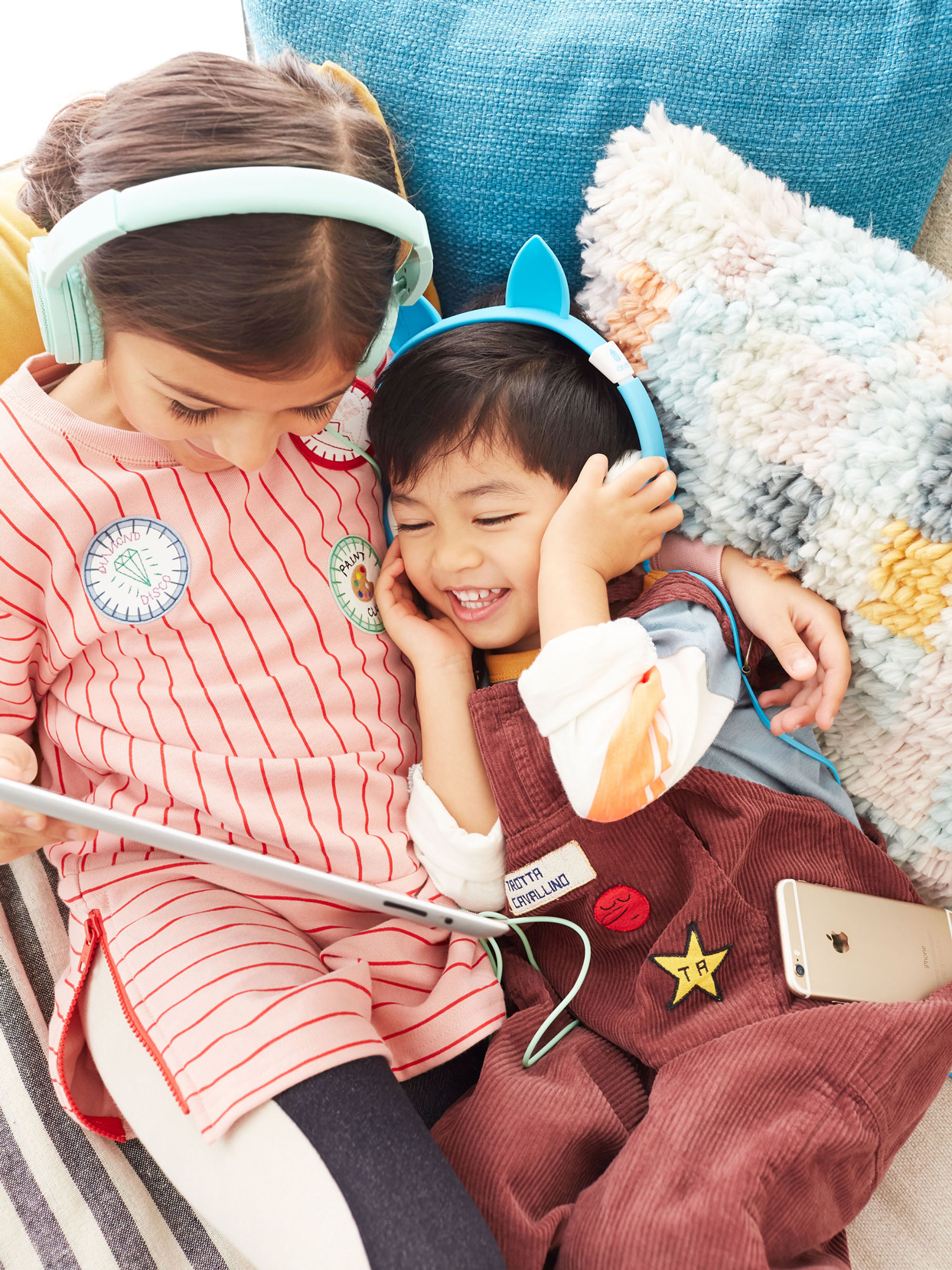 two children wearing headphones listening to audio book