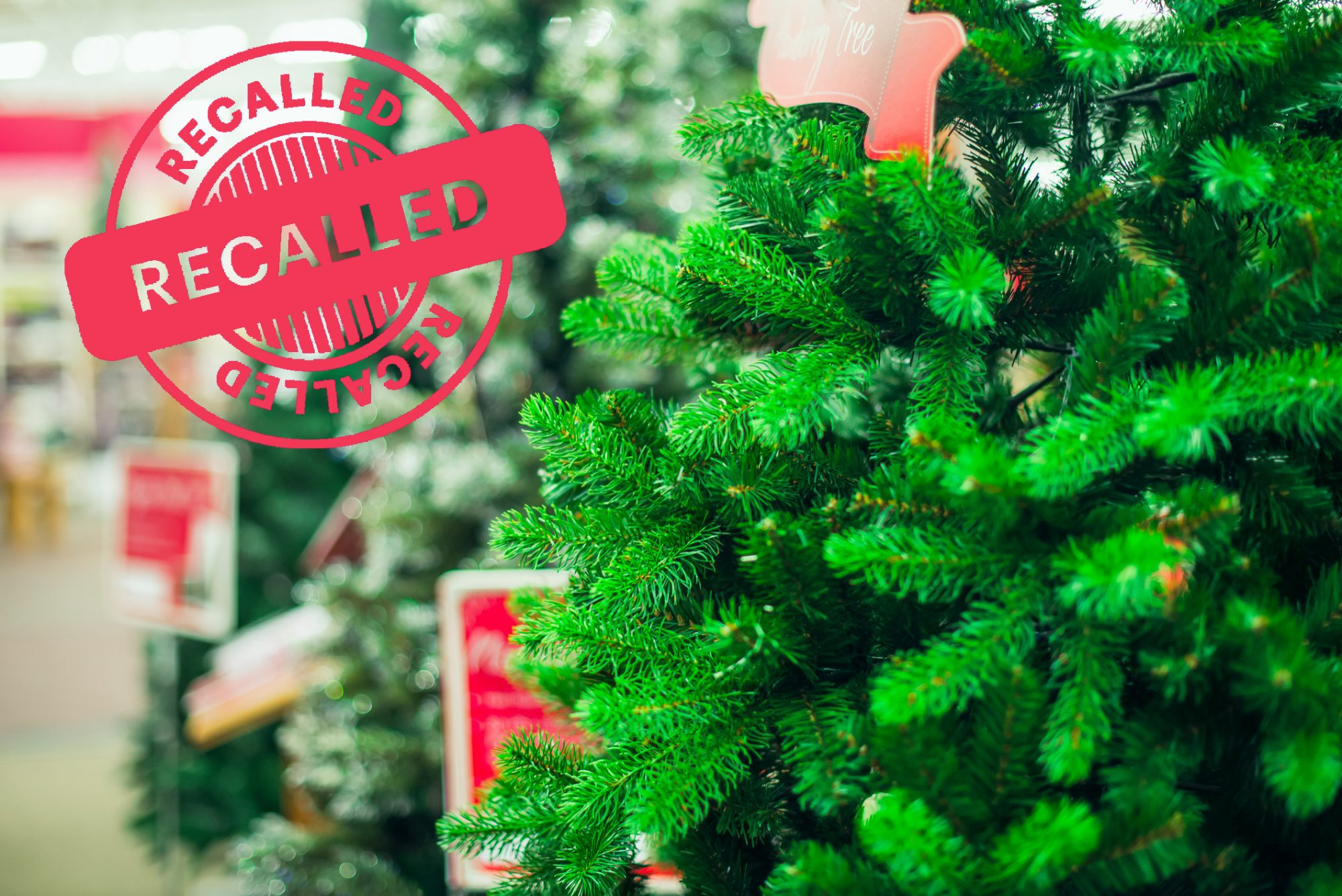 Close up artificial green Christmas trees for sale with Recalled Stamp overtop image