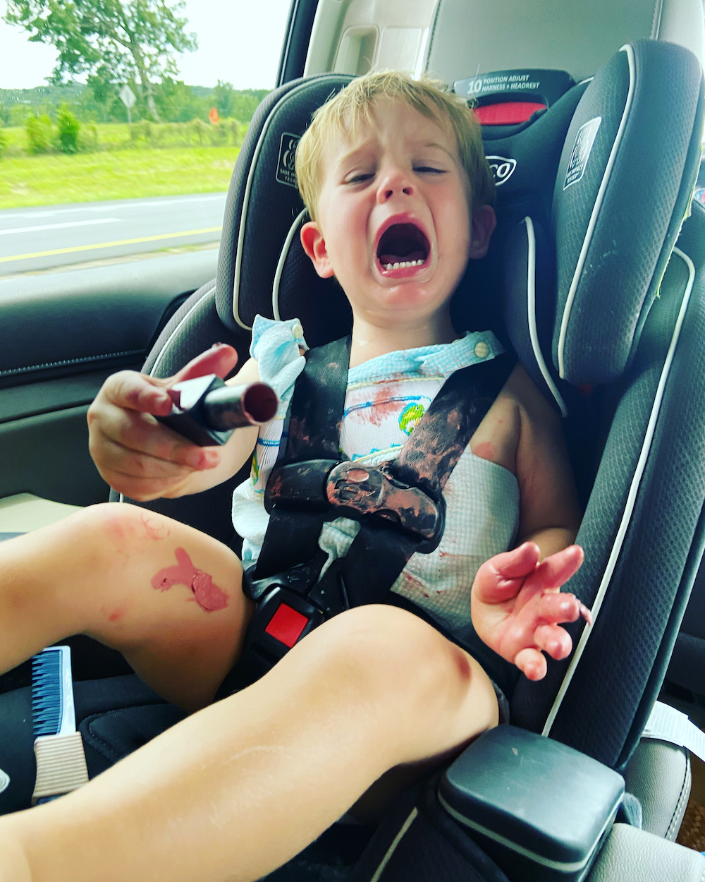 Lynn Smith's son cries in the car.