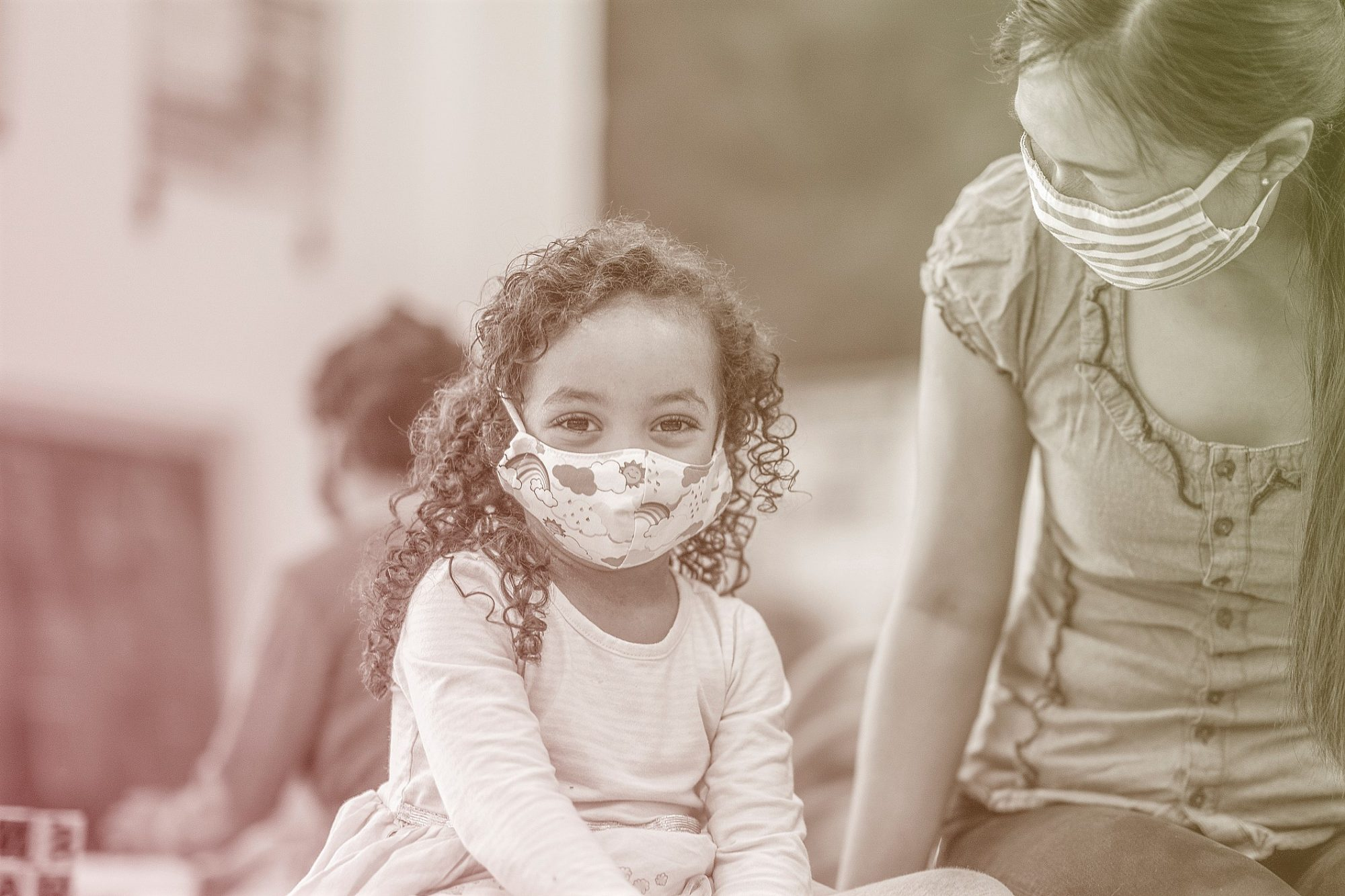 young girl wearing face mask at daycare