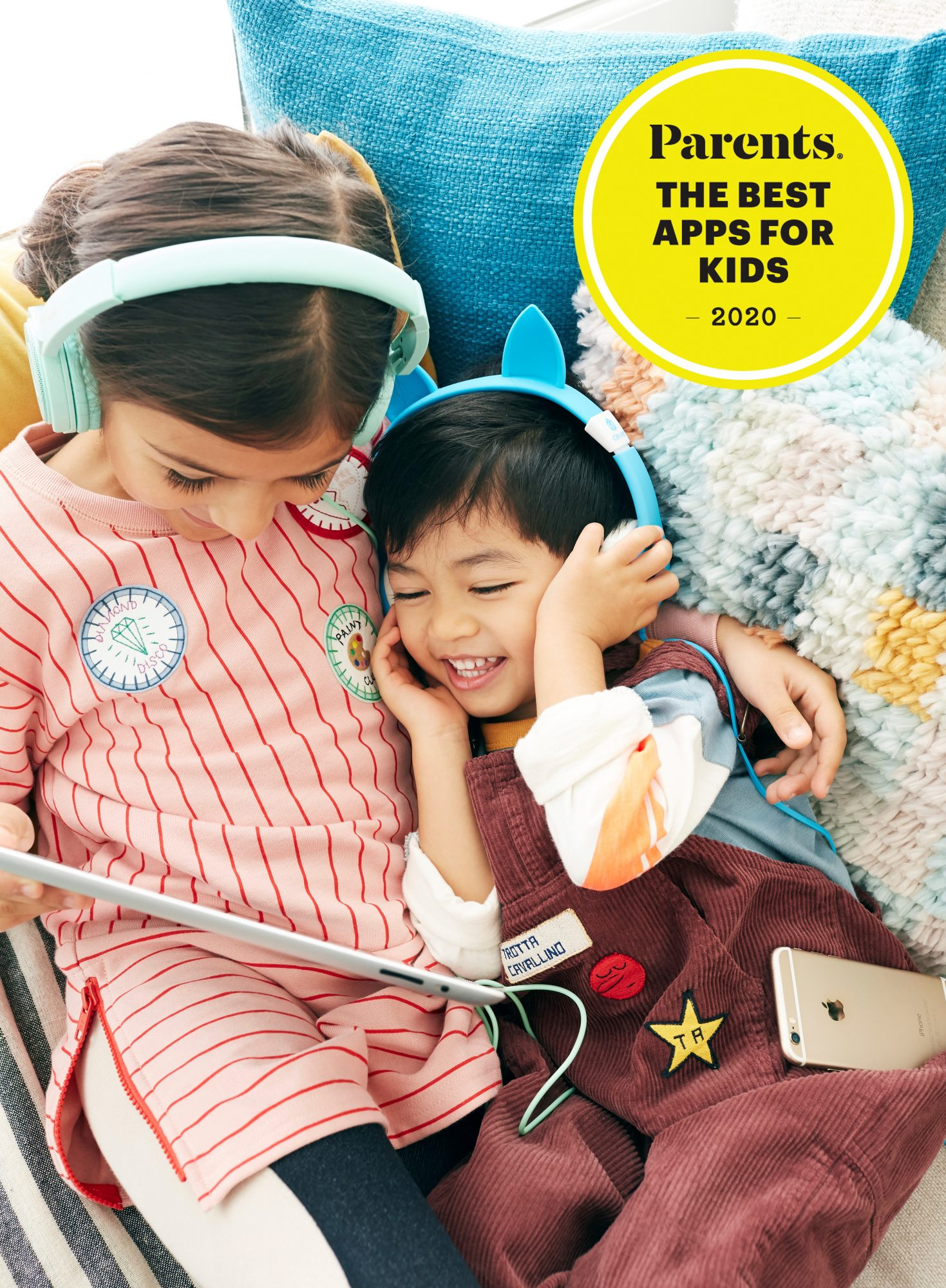 two kids wearing headphones looking at tablet
