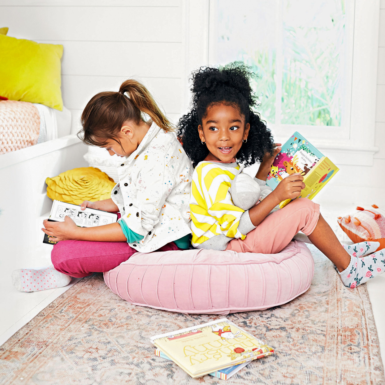 Girls reading books pink cushion