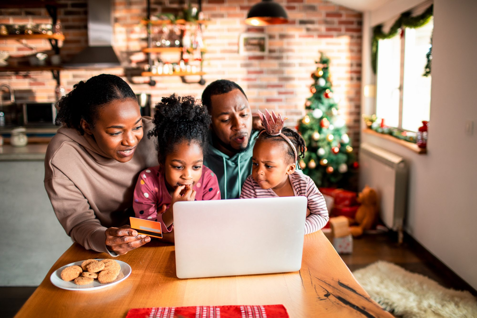 family shopping online; christmas decorations in background