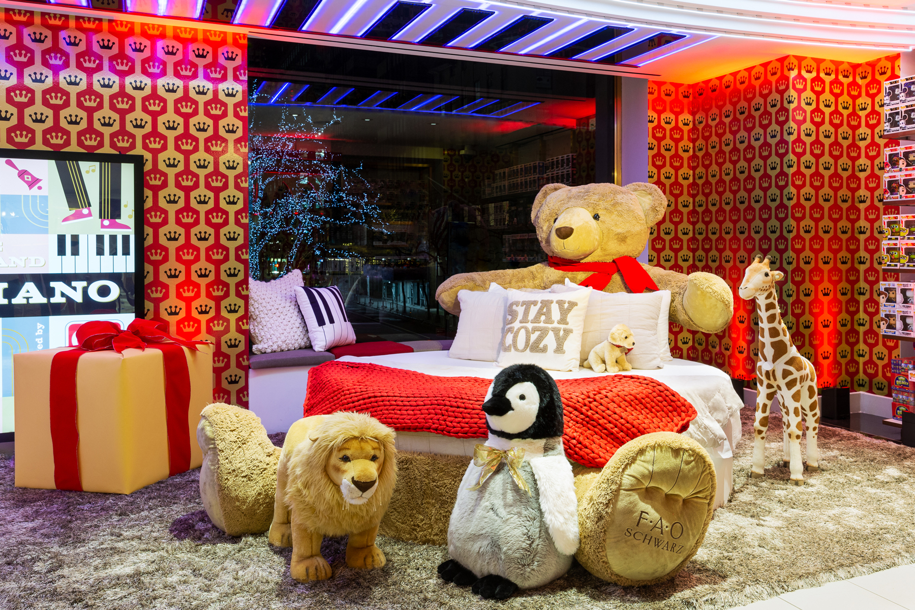 inside of fao schwarz, circle bed and giant stuffed animals