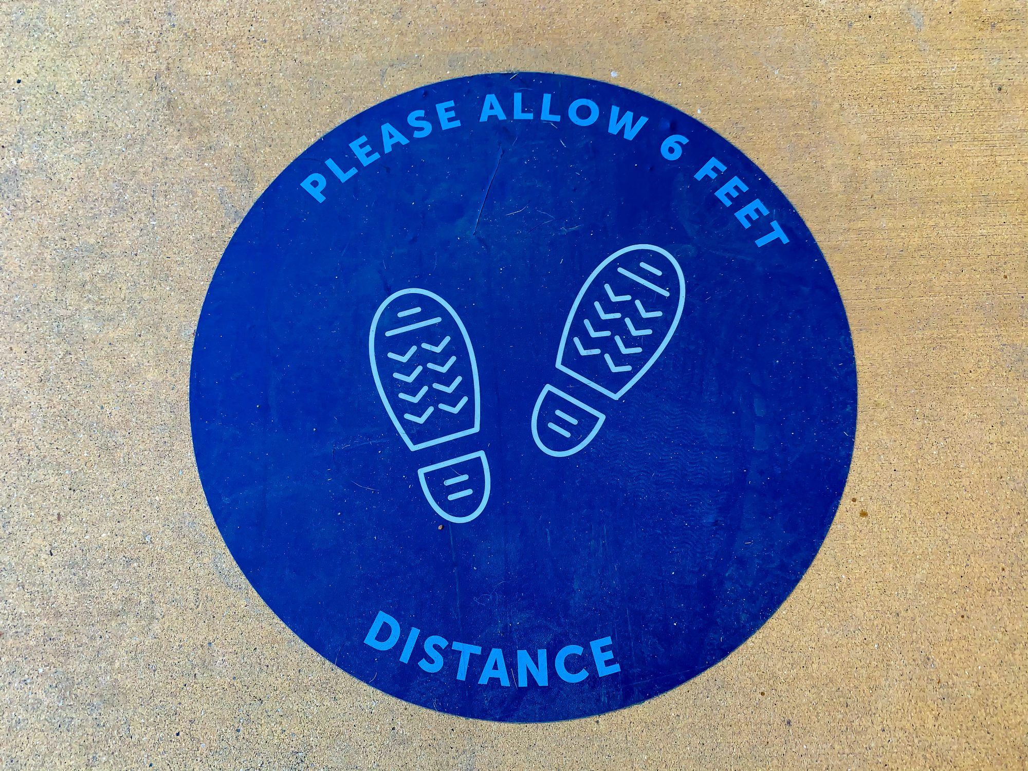 An image of a social distancing sign.