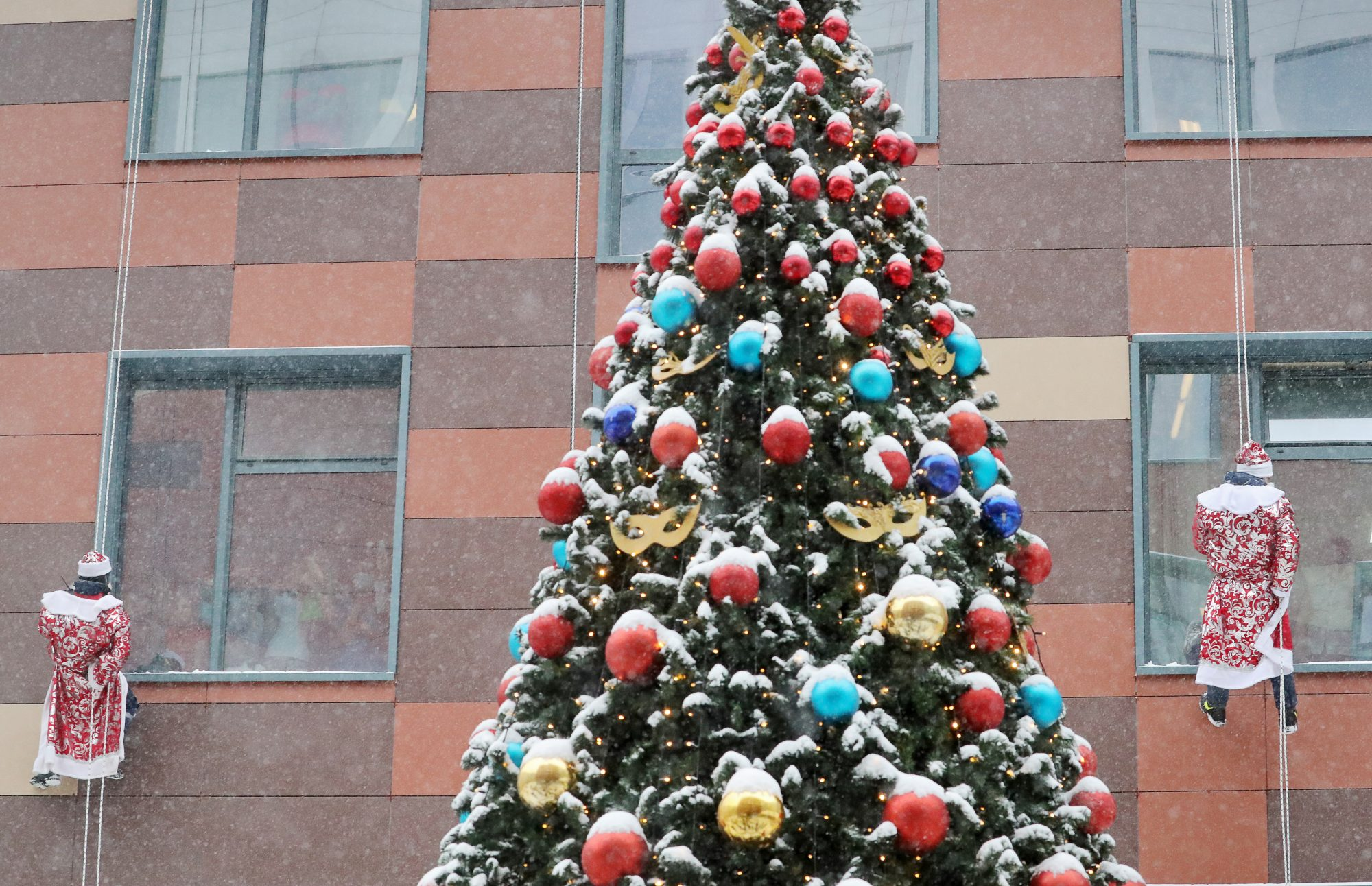 Christmas tree in front of hospital building windows