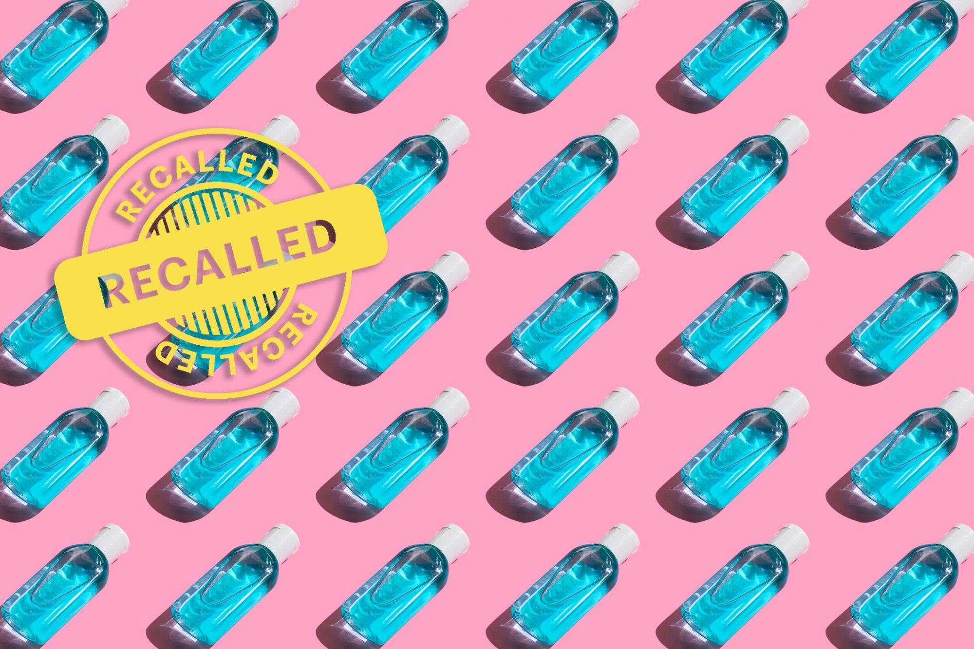 """Pattern Of Antibacterial And Hand Sanitizer On A Pink Background with """"recalled"""" stamp"""