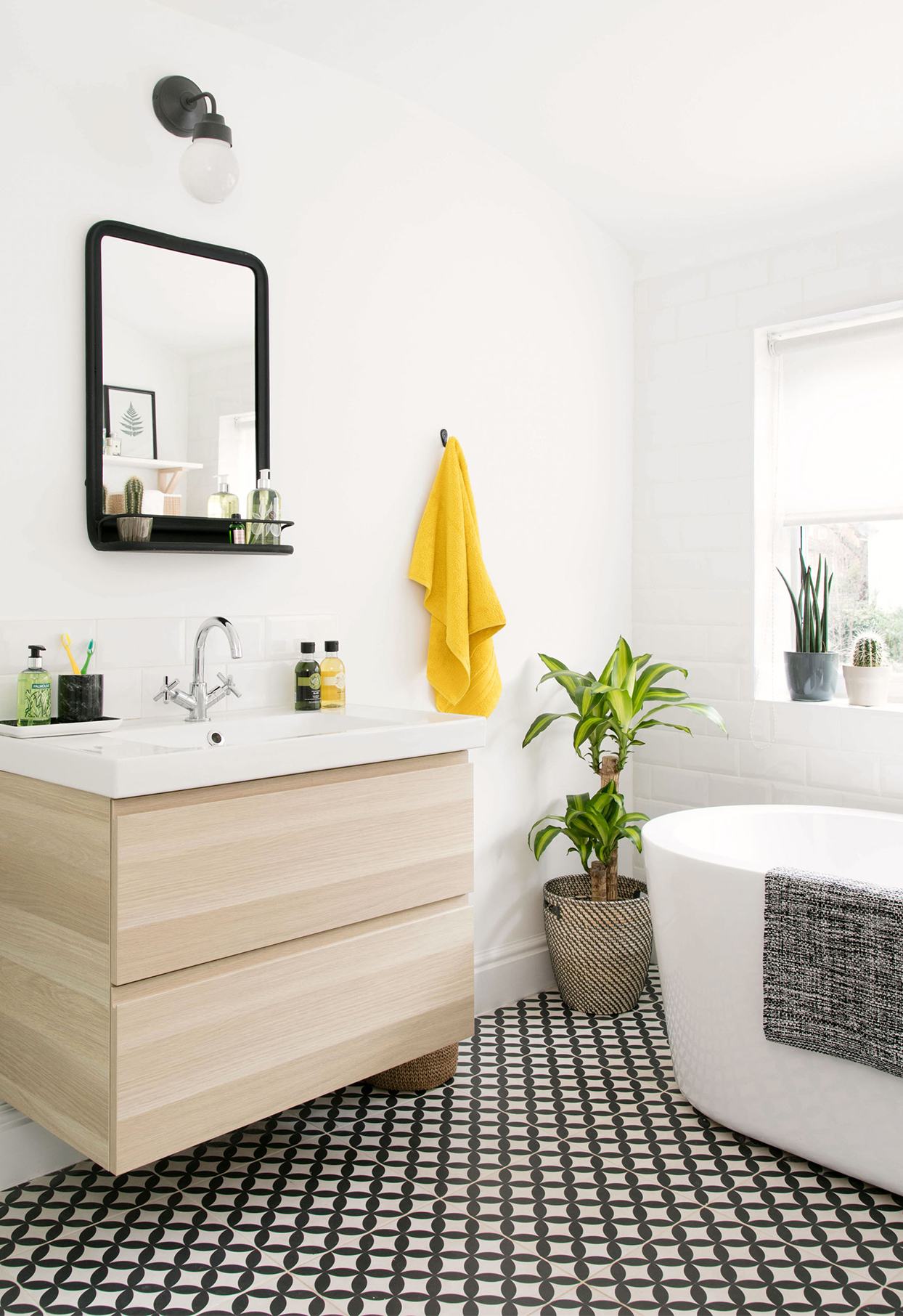 white and black bathroom with bright yellow accents