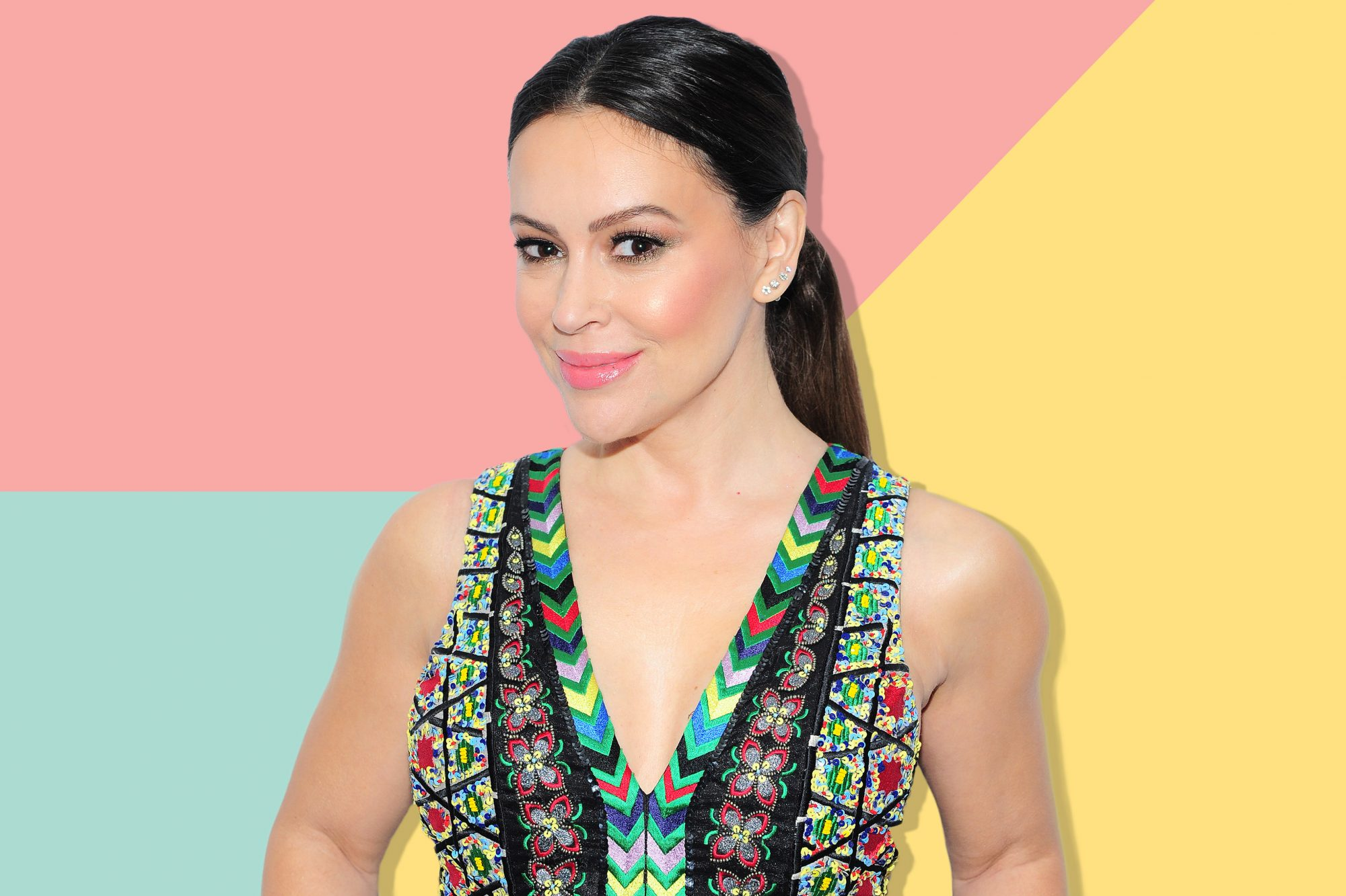 An image of Alyssa Milano on a colorful background.