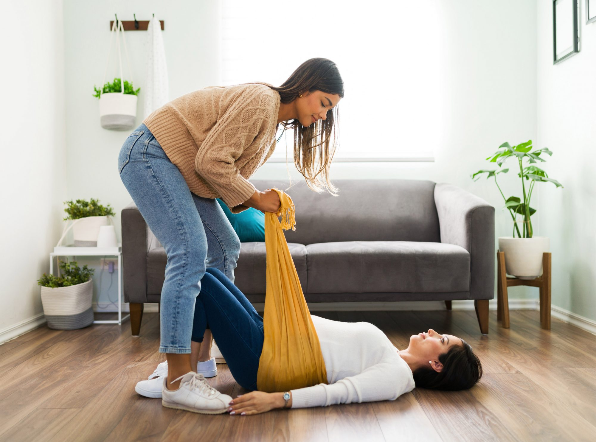 An image of a doula helping a pregnant woman.