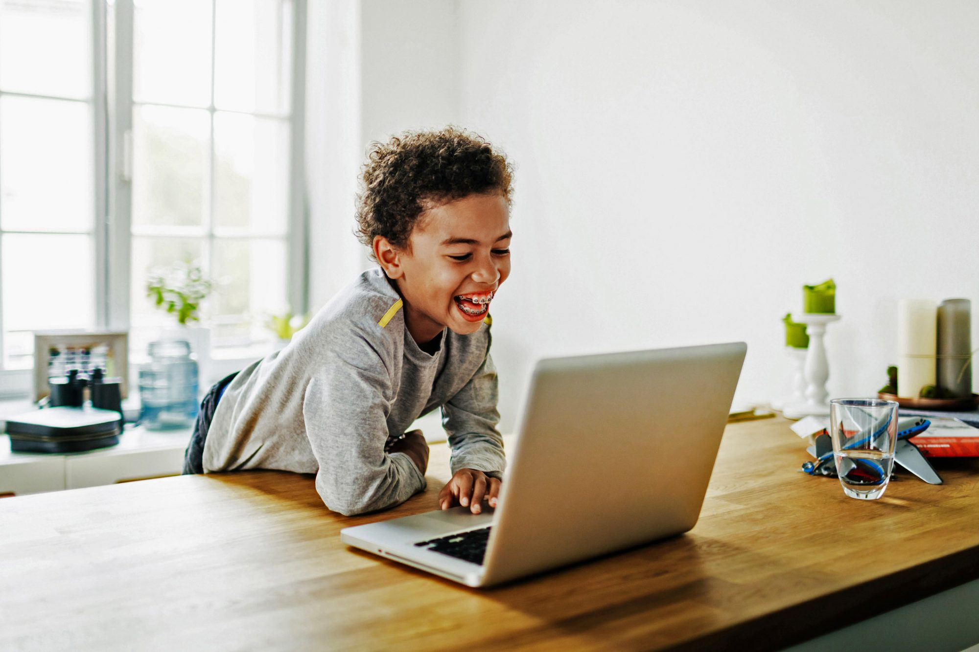 An image of a young boy on a laptop.