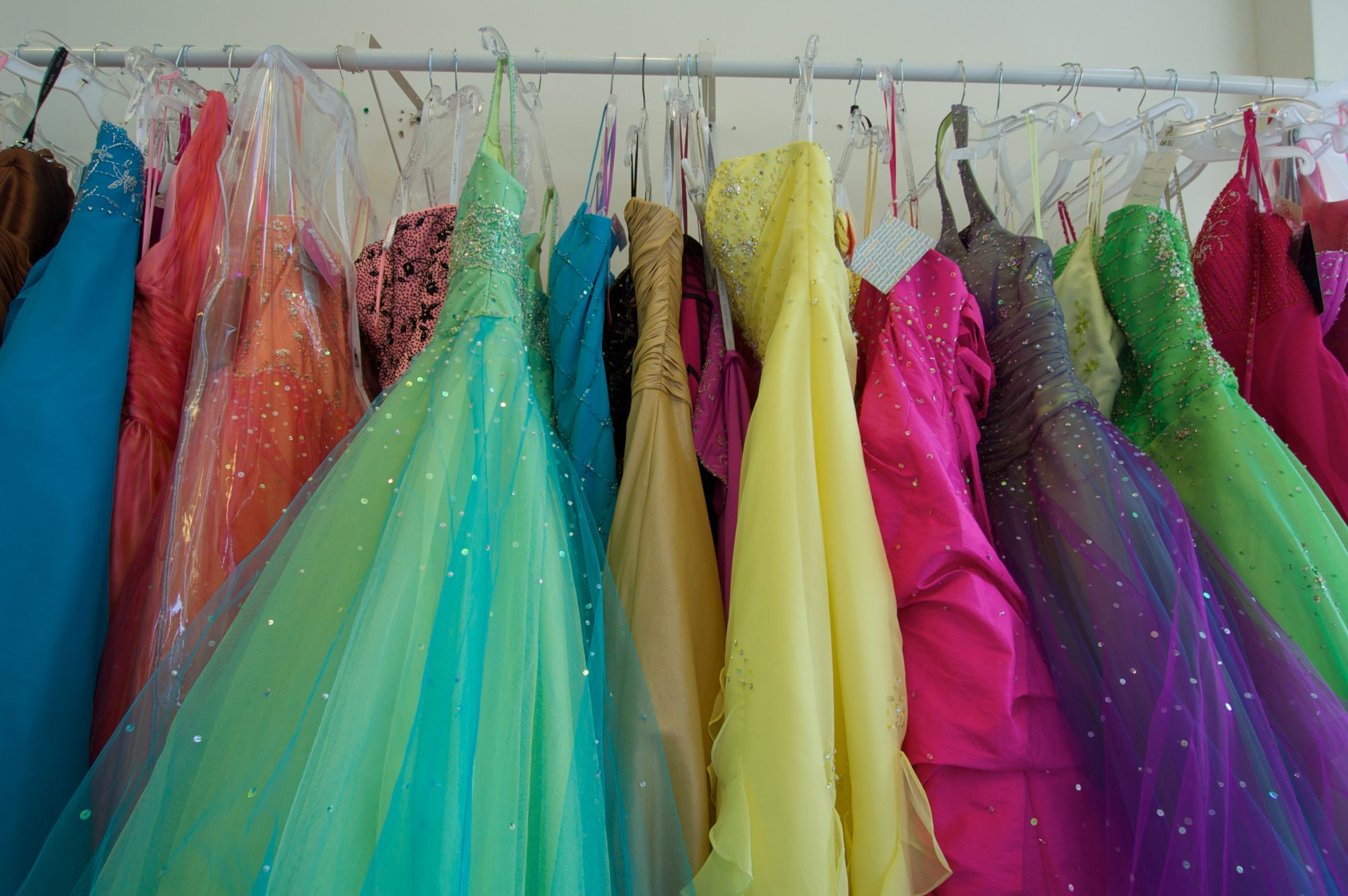 Colorful Prom Gowns Hanging on Rack