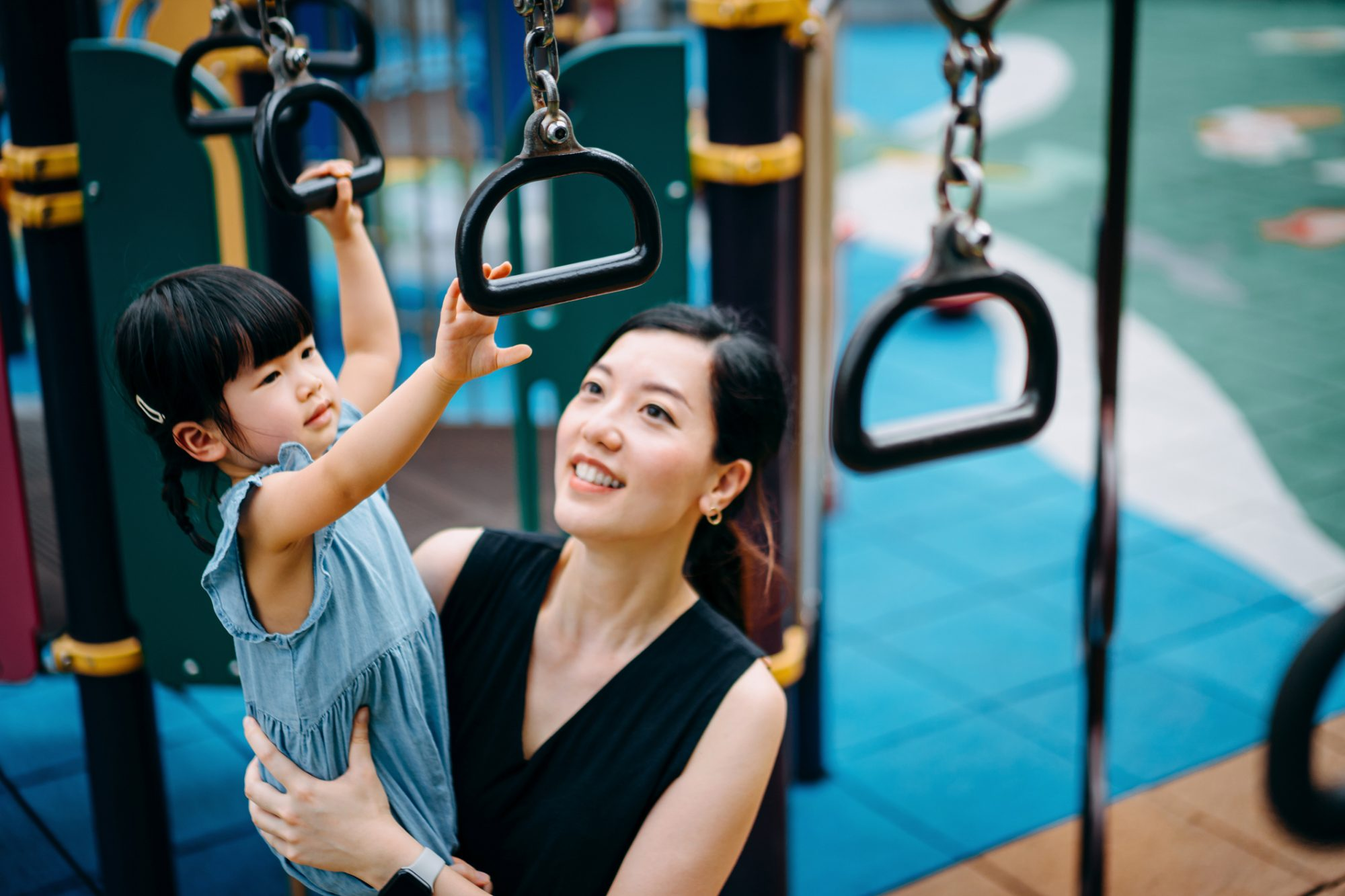 An image of a mother with her daughter at the playground.