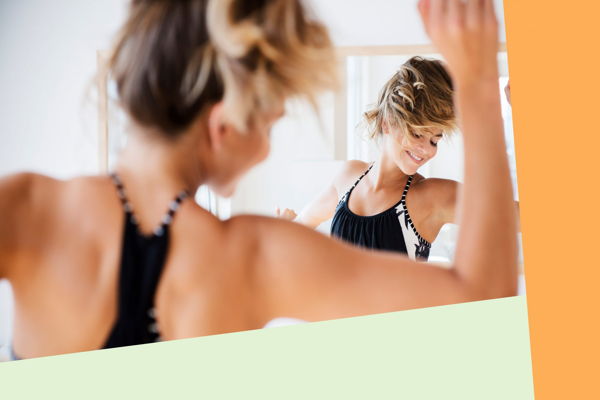 An image of a woman dancing in the mirror.