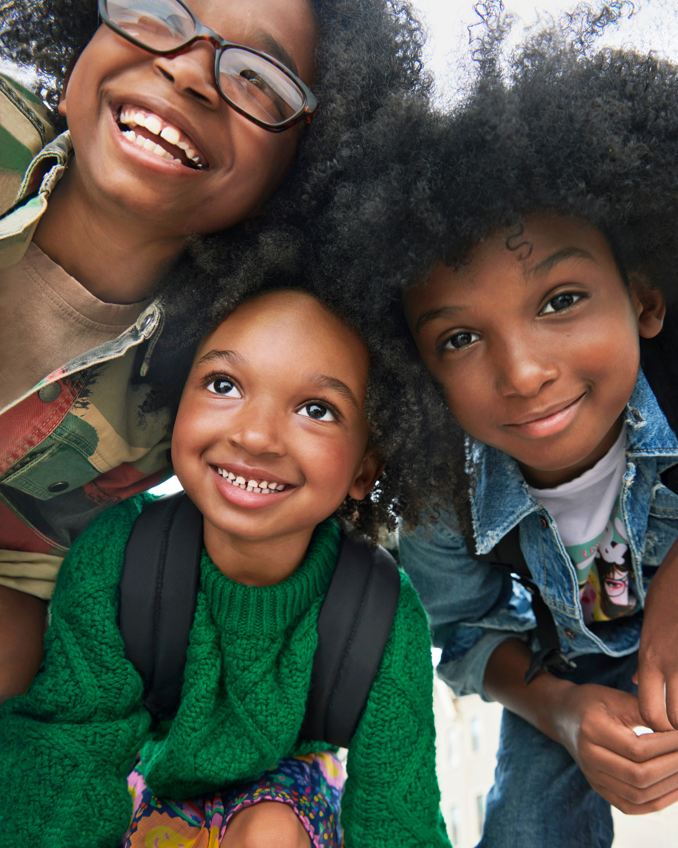 Three Kids Smiling Back to School Clothes