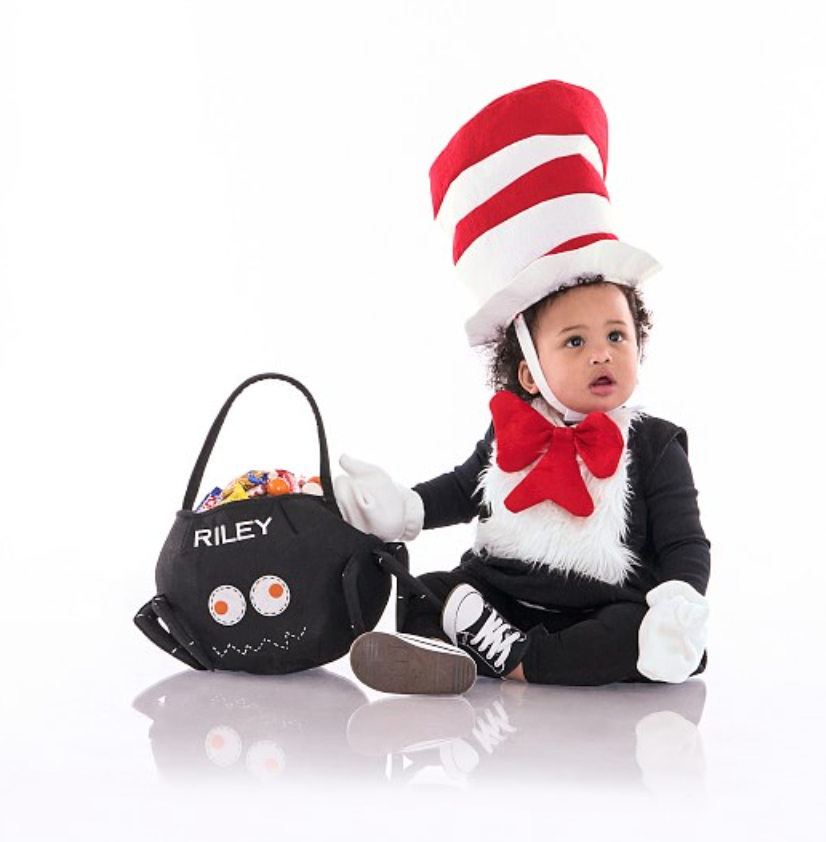This baby's first Halloween costume honors a classic storybook: The Cat in the Hat by Dr. Seuss. We can't get enough of the enlarged hat and bow tie!