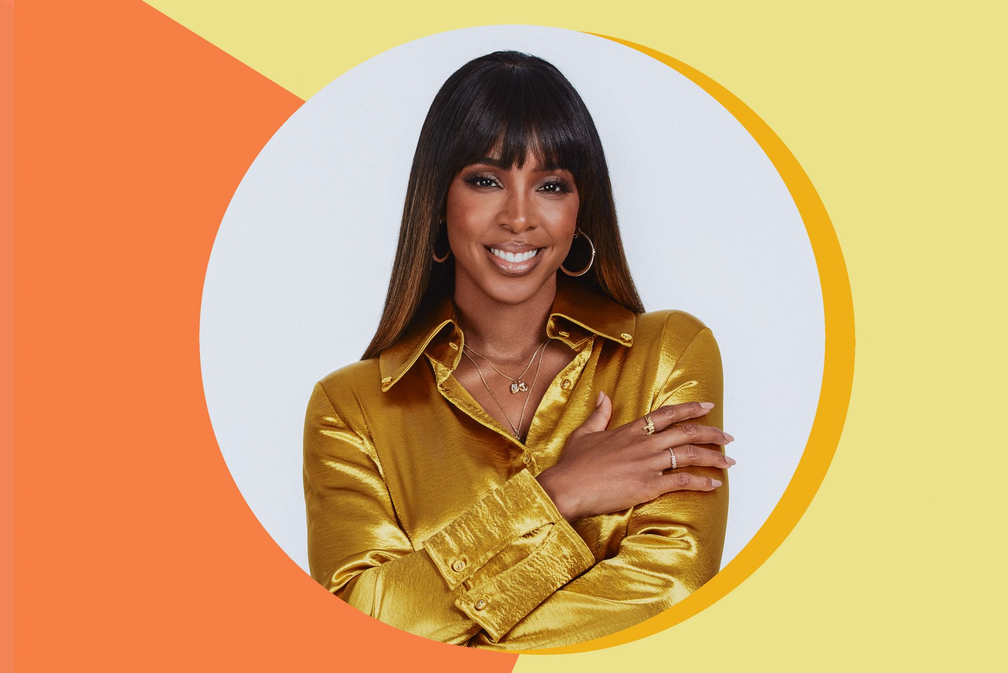 An image of Kelly Rowland on a colorful background.