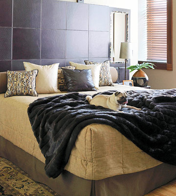 A master bedroom with light -- and leather